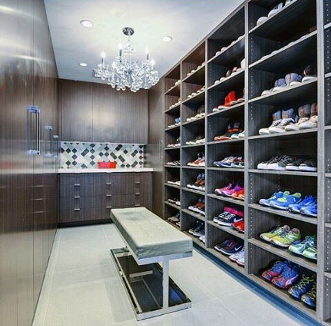 bachelor-pad-sneaker-closet-with-ceiling-chandelier.jpg