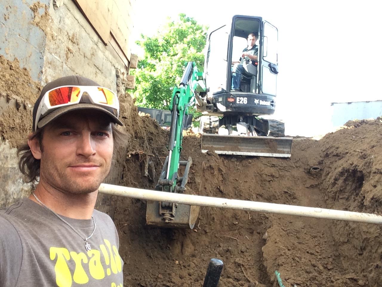 jesse in foundation hole.jpg
