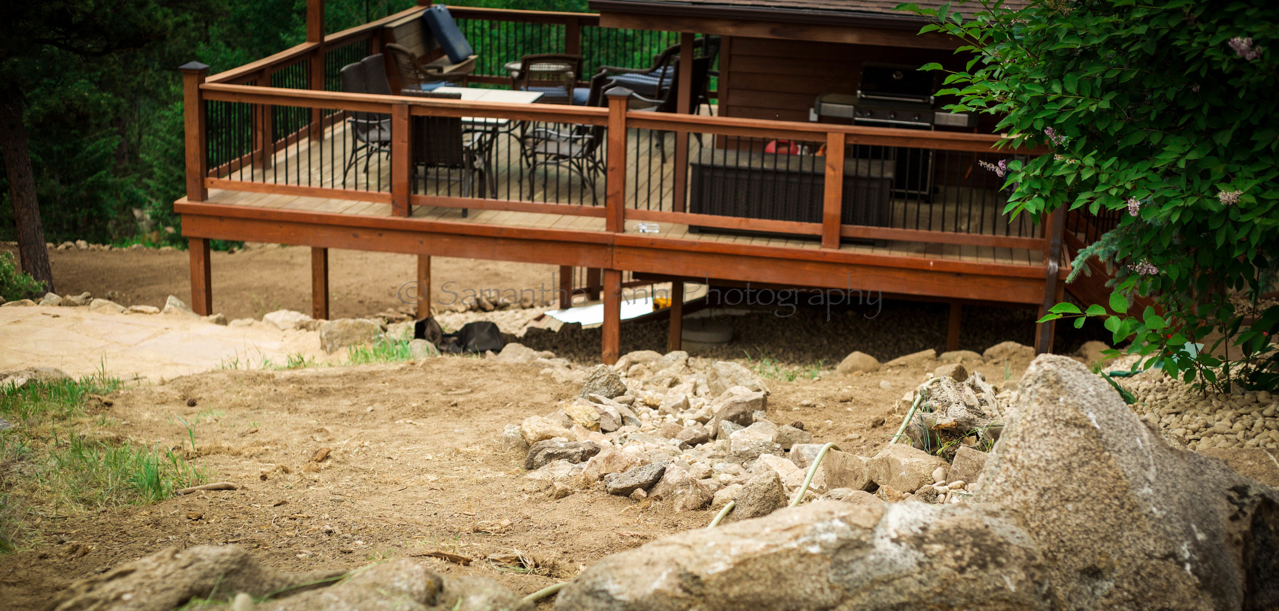Looking down towards the deck and patio for future hot tub.