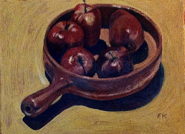 Red apples in a brown dish