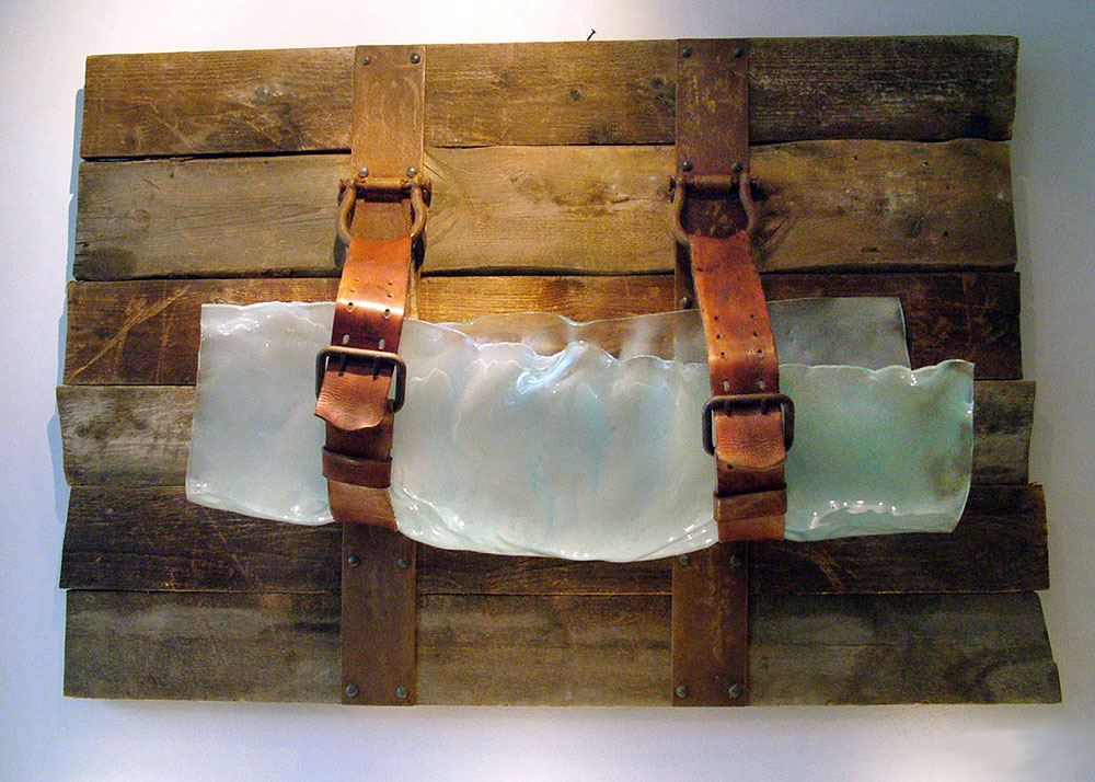 A BAG FOR THE MYTHOLOGICAL TRAVELER Slumped glass, wood, mixed media  36 x 51 x 14""