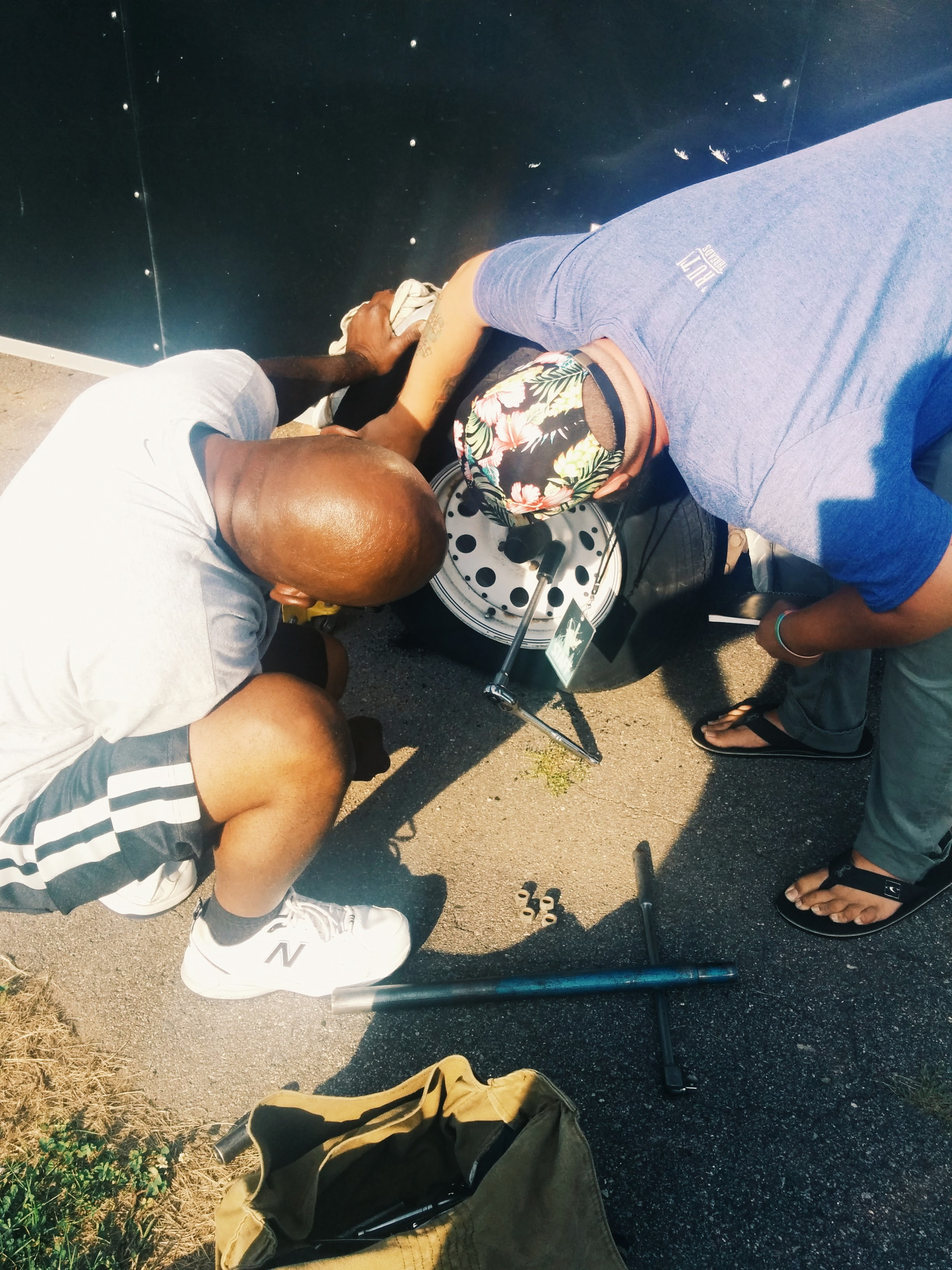 Sergio and Sam working on replacing a tire.