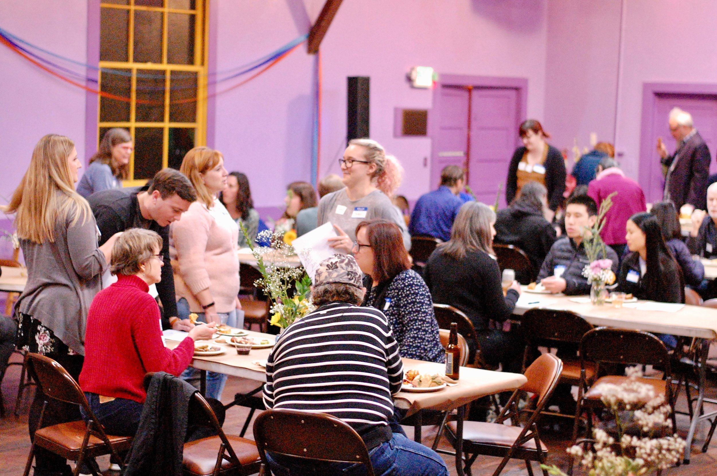 Hali and other volunteers catch up during our annual Winter volunteer party.