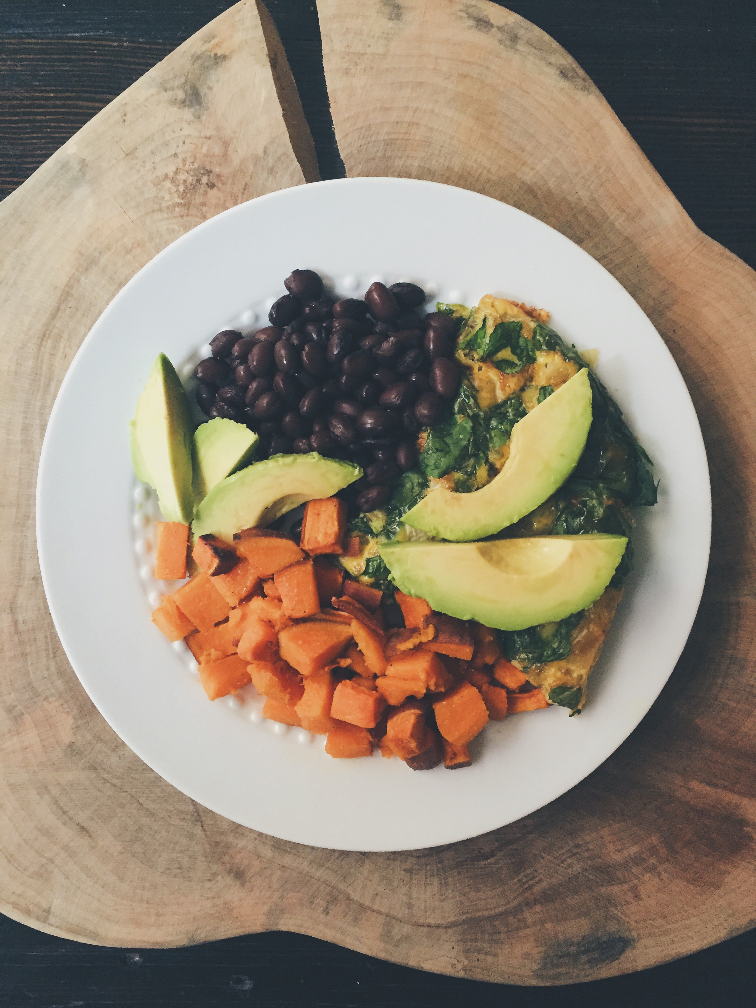 Broiled Vegetarian Frittata with a side of homemade sweet potatoes and black beans