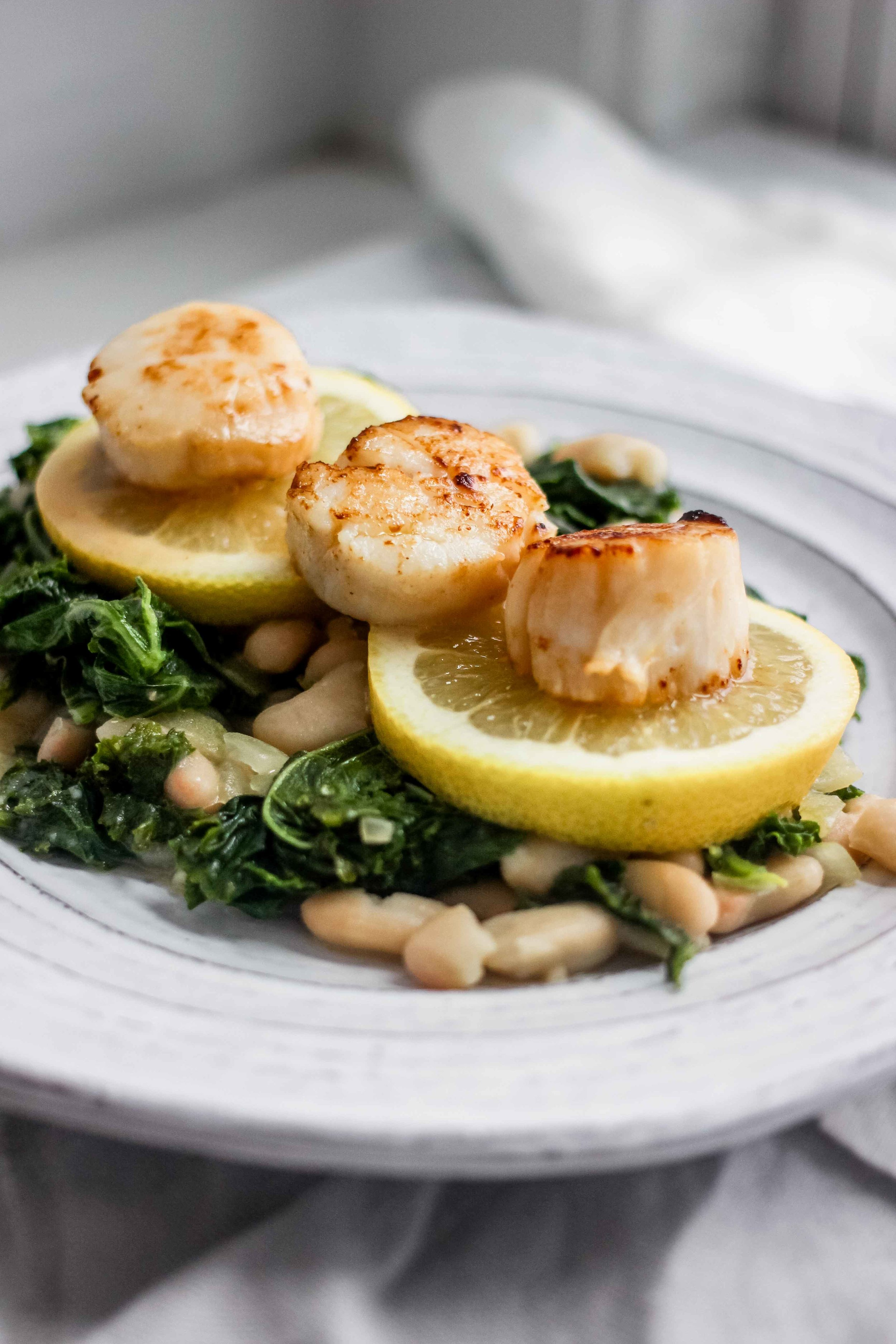 Seared Lemon Butter Scallops With Kale and White Beans - The Well Essentials