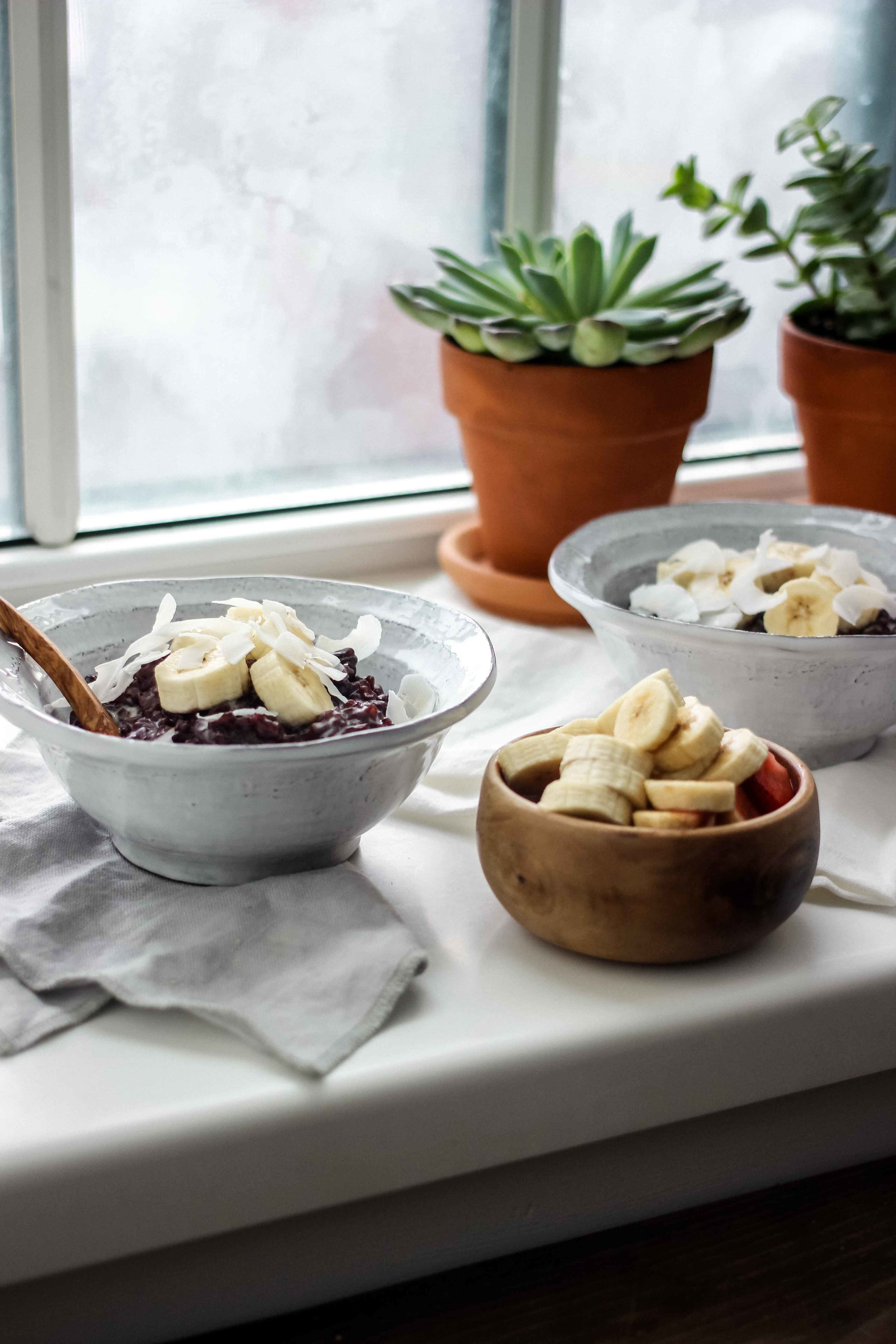 Balinese Coconut Black Rice Pudding With Banana - The Well Essentials