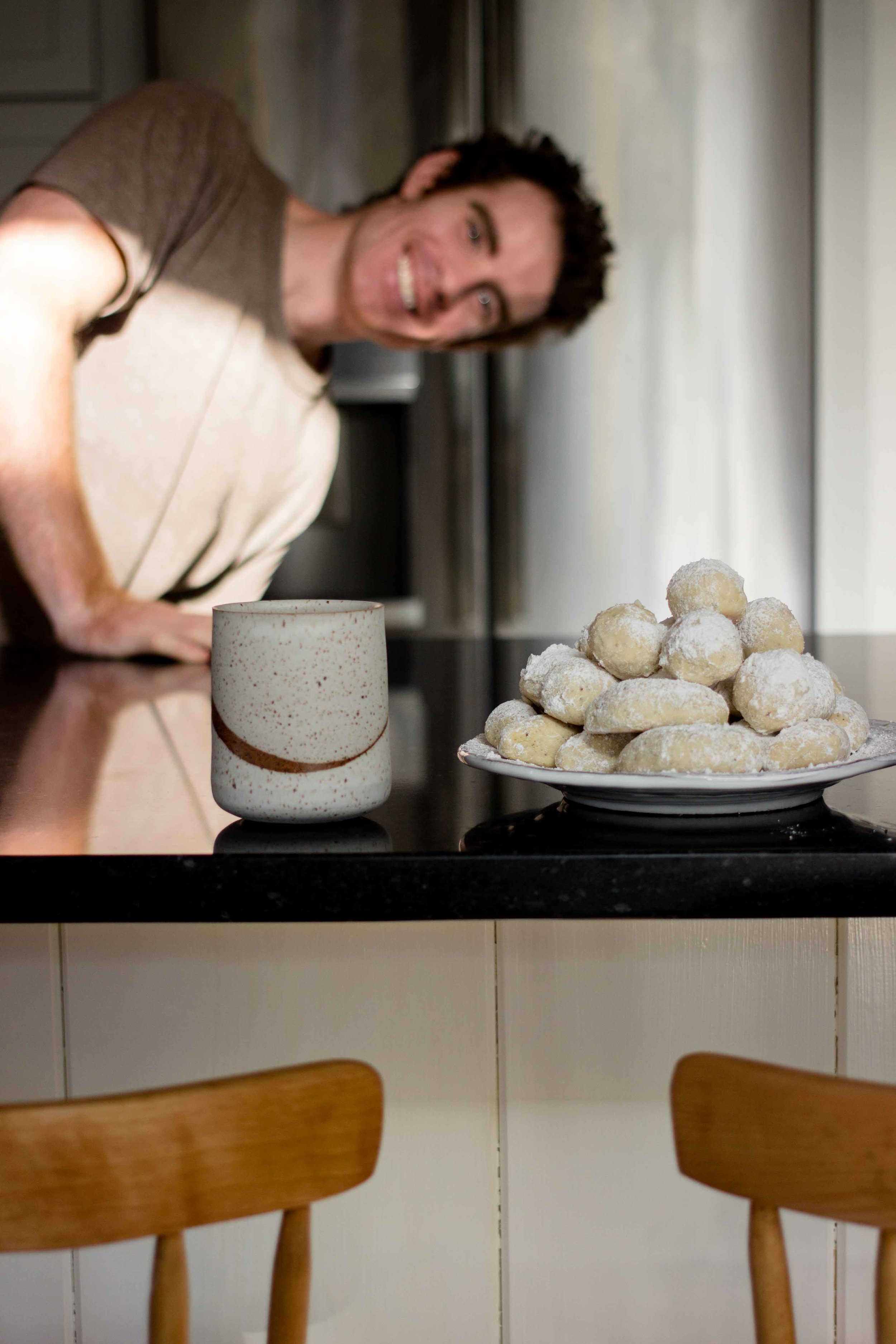 Gluten Free Greek Kourabiedes (Greek Christmas Butter Cookies) - Melt in your mouth almond and buttery cookies piled high with powdered sugar you wont be able to resist - The Well Essentials #christmasfood #christmascookies #greek
