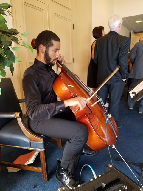 Elijah on cello at Norfolk Yacht.jpeg