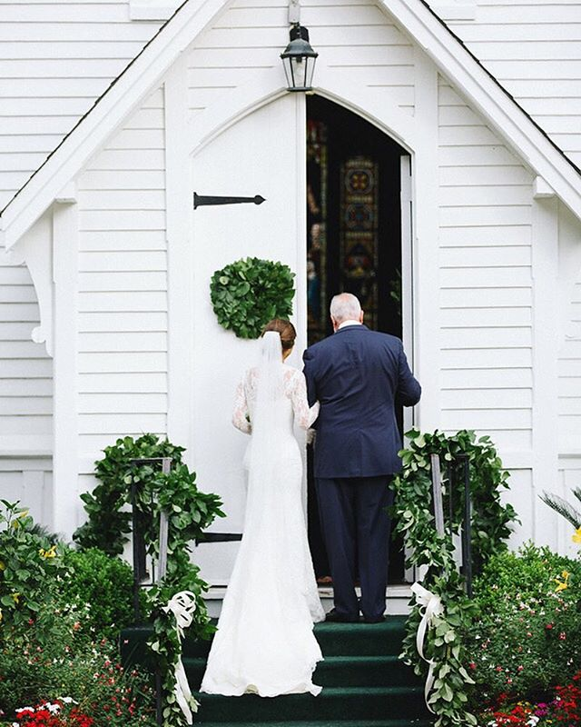 Lush green wreaths and garlands highlight the simplistic beauty of this sweet southern chapel🌿  #emilyellisonstudio