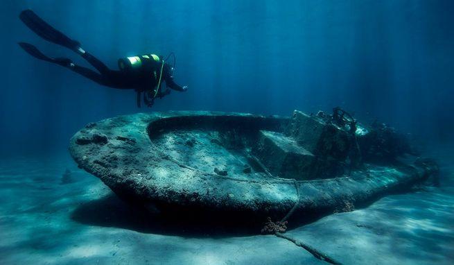 A diver and sunken boat at Blue Heron Bridge.  John Michael Bullock