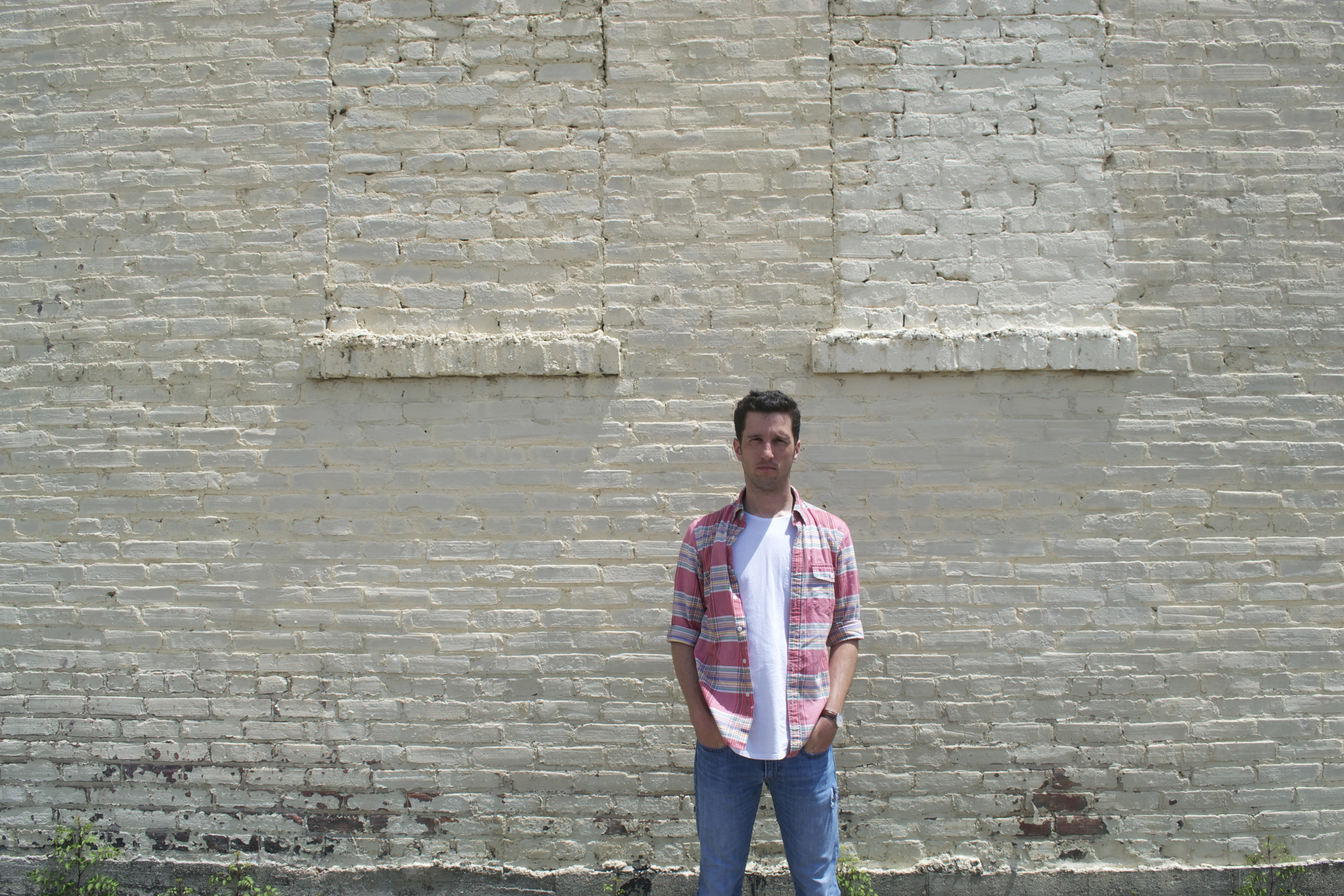 posed-brickwall