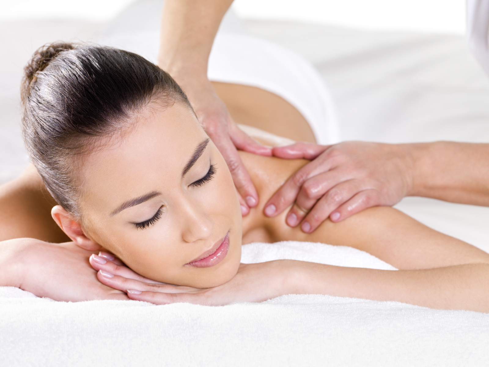 Woman having massage. Stock image. Credit Veritas med center.