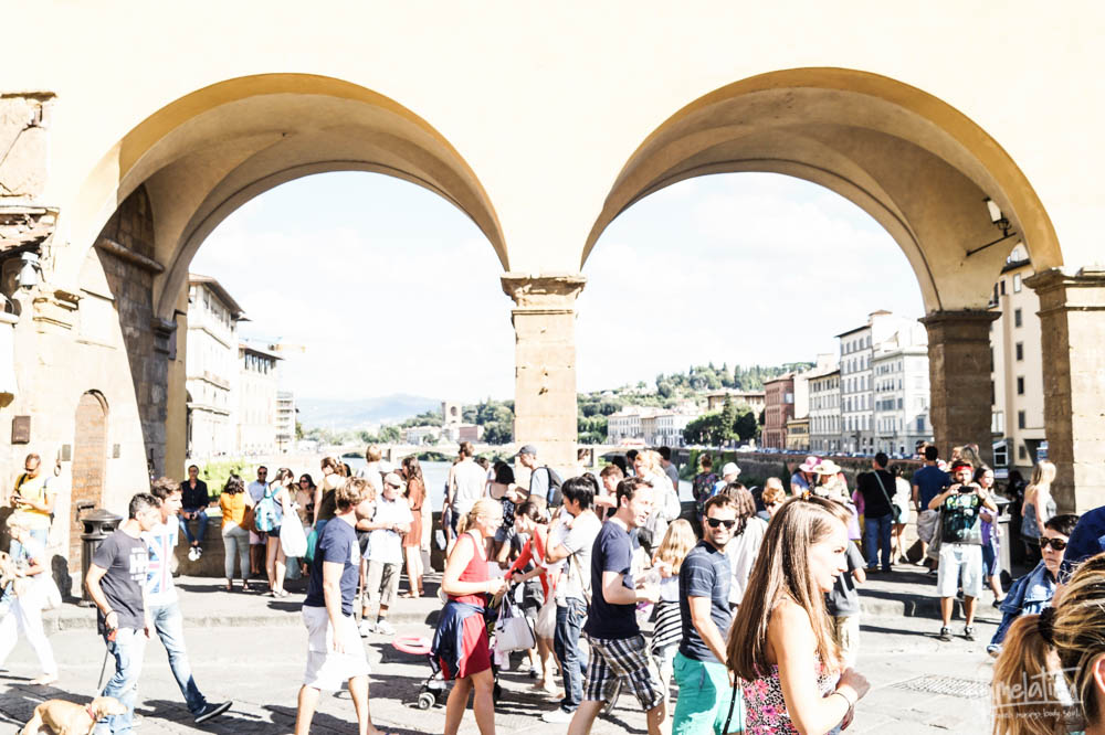 Florence. Ponte Vecchio. Tuscany, Italy. People walking.
