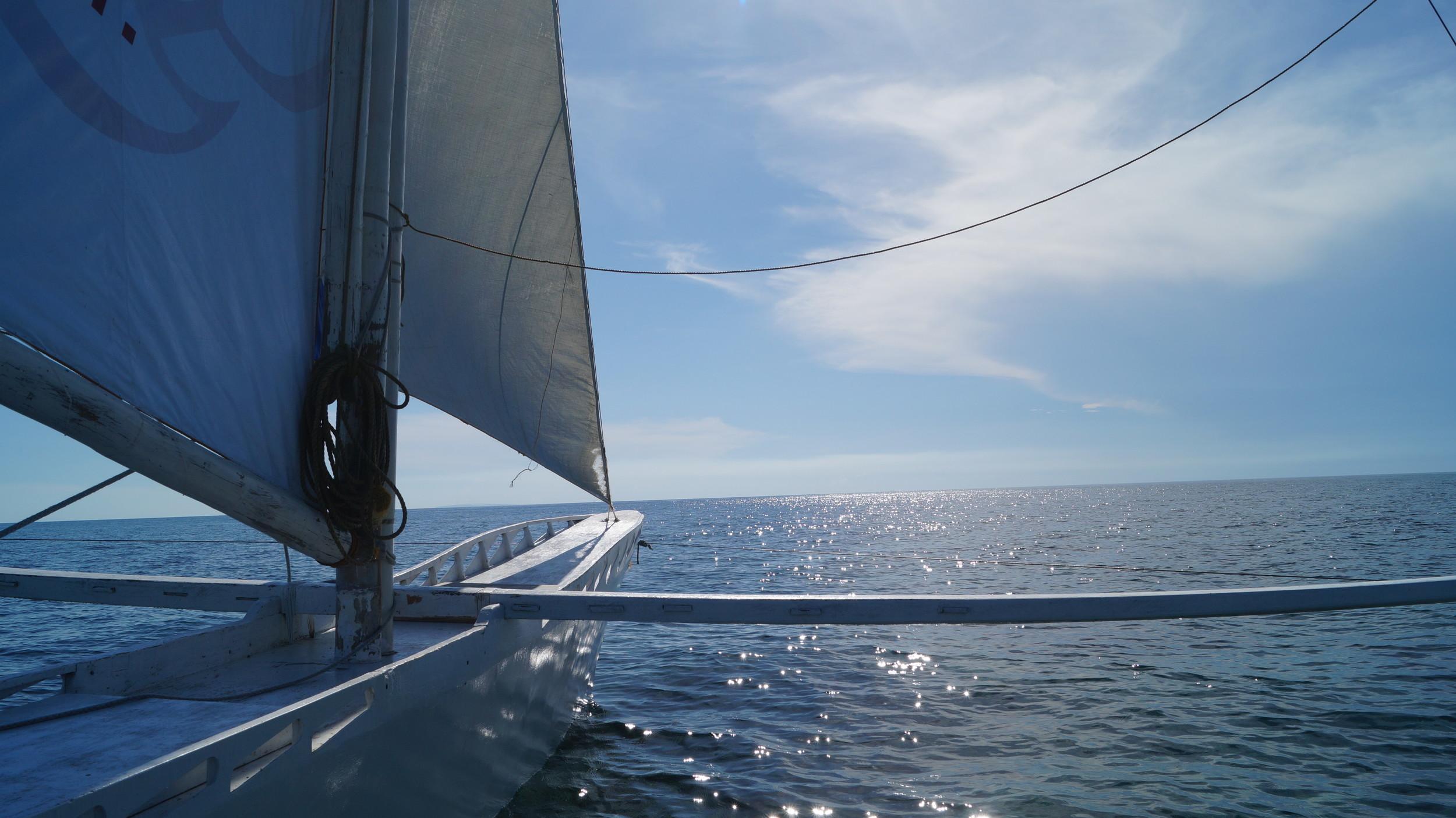 Local boatman on yacht with Boracay horizon