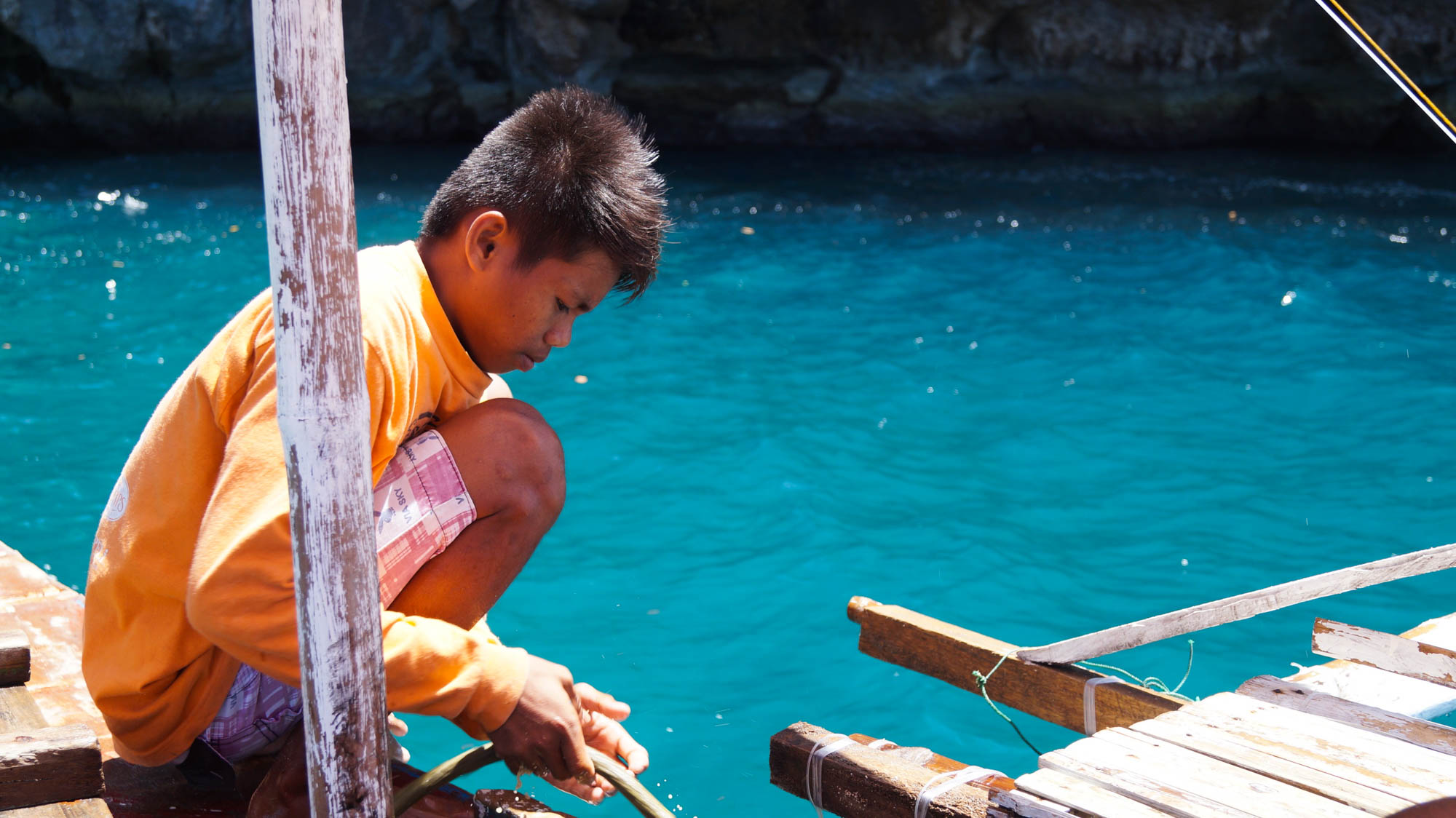 Islas de Gigantes - Local kid on bangka - Philippines - illumelation