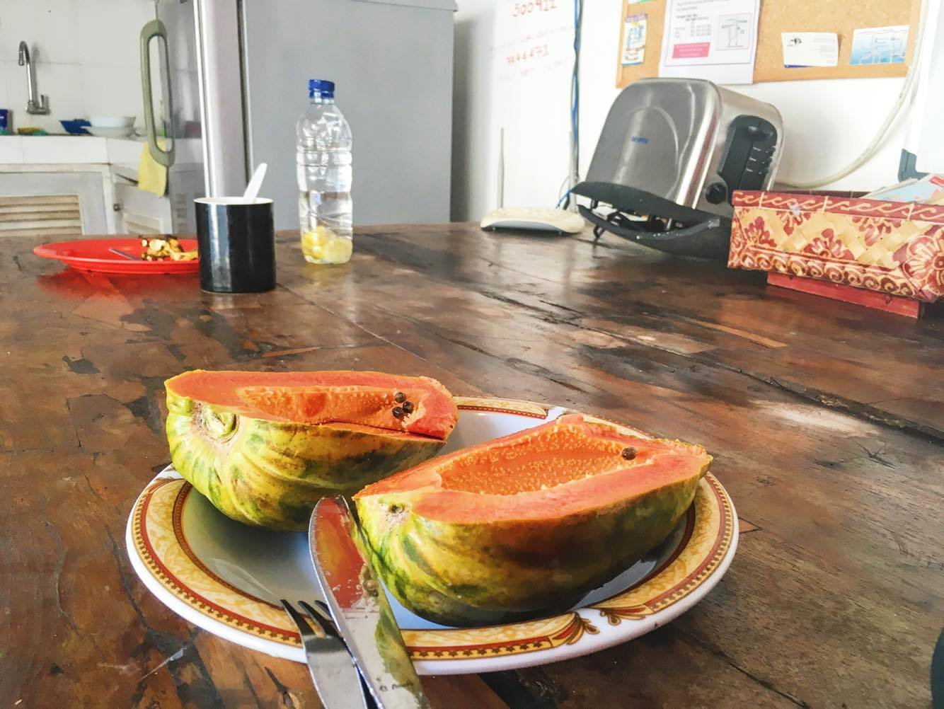 My very cheap, very exotic breakfast of fresh papaya at the shared kitchen table. Plus broken (but still somehow functional) toaster.