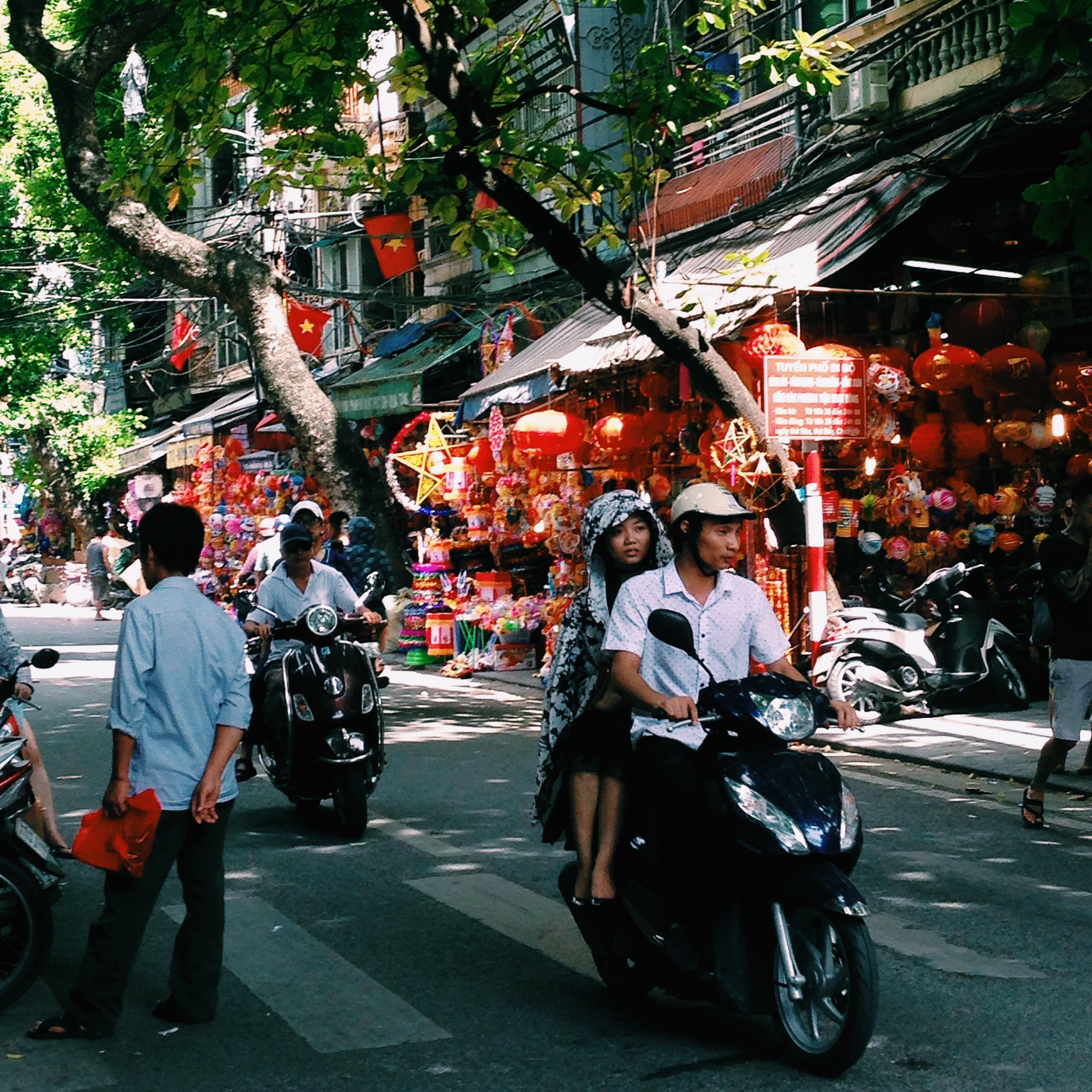Couple on Motorbike in Hanoi, Vietnam - illumelation.com