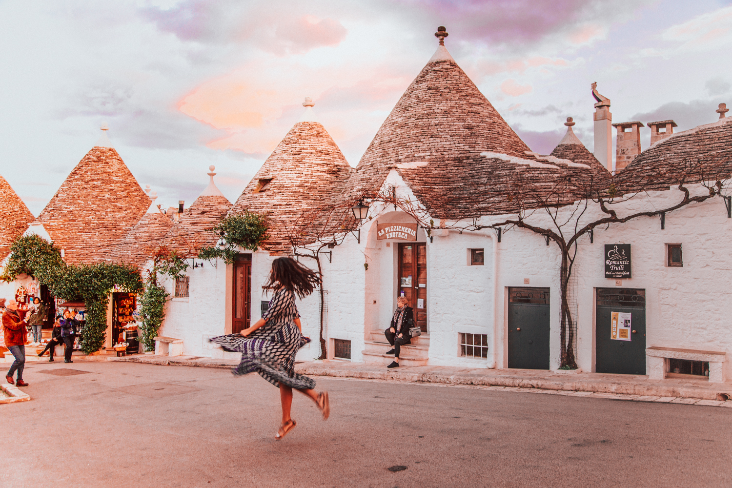 Twirling in Alberobello, UNESCO site in Puglia, Italy