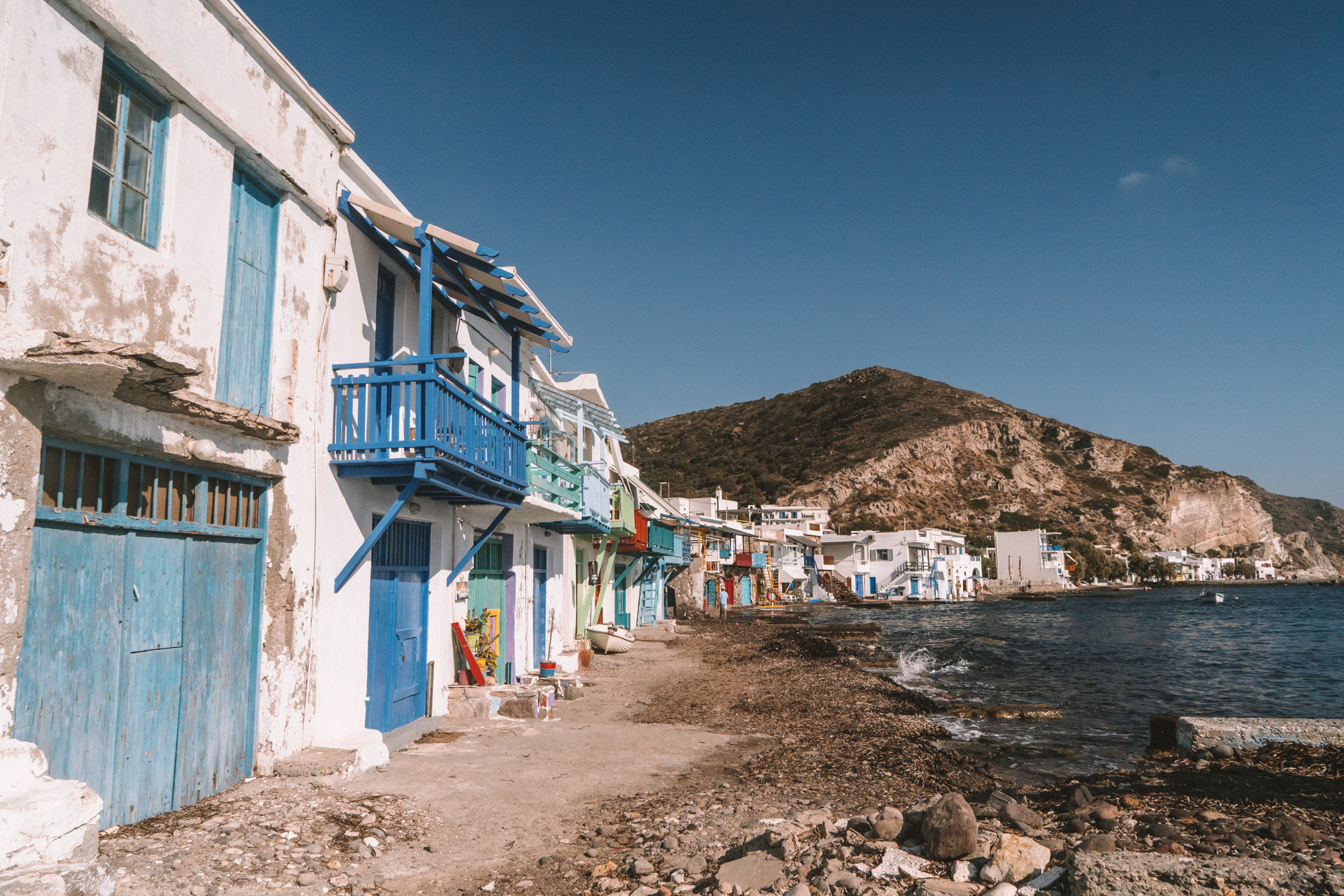 Rows of colourful fishing houses by the sea in Klima Fishing Village Milos, Greece