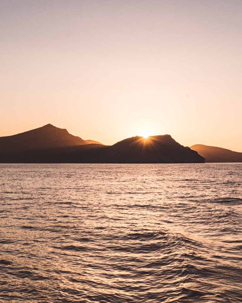 Sunset on the sea in Milos, Greece