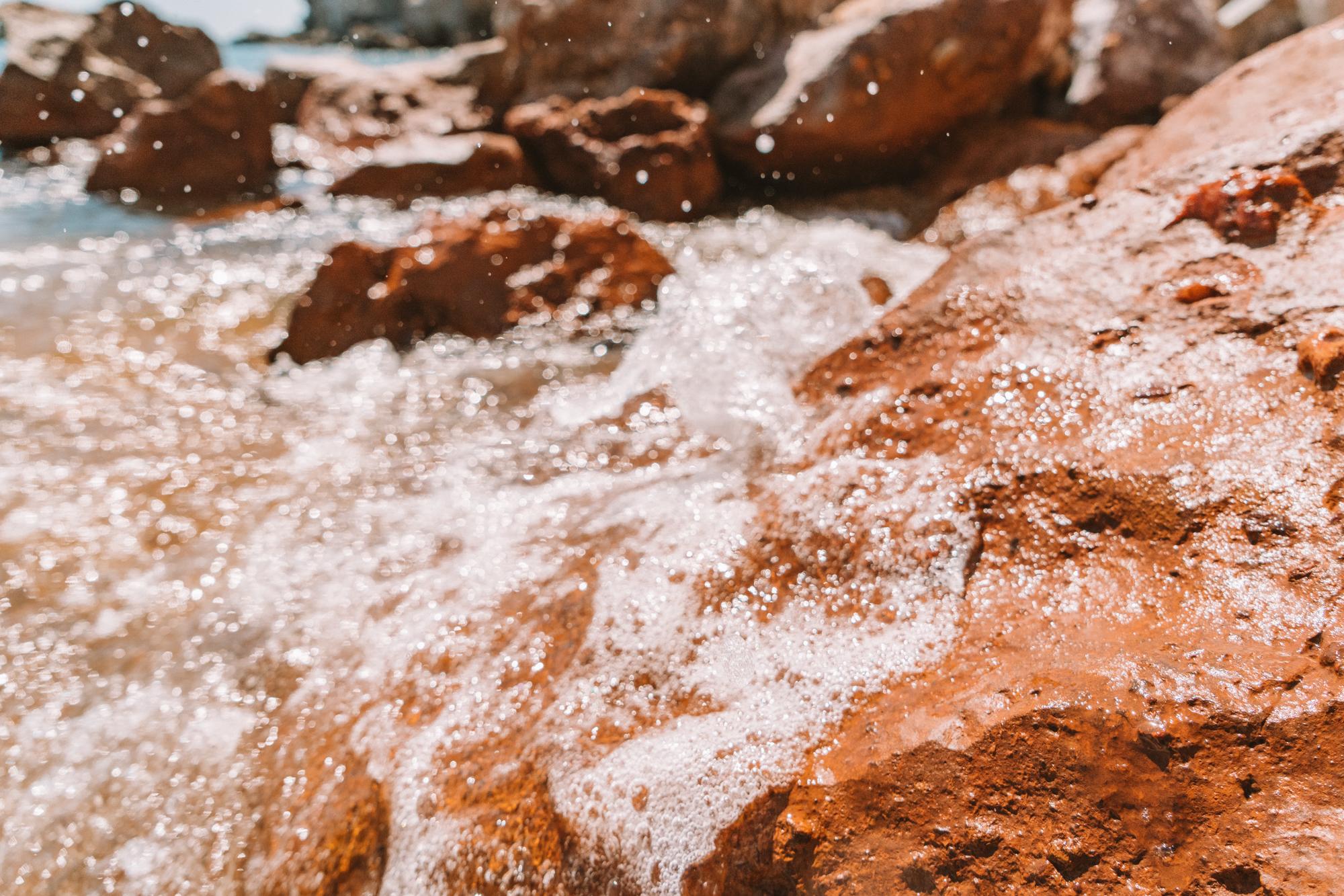 Rock details close-up at Paleochori Beach, Milos Greece
