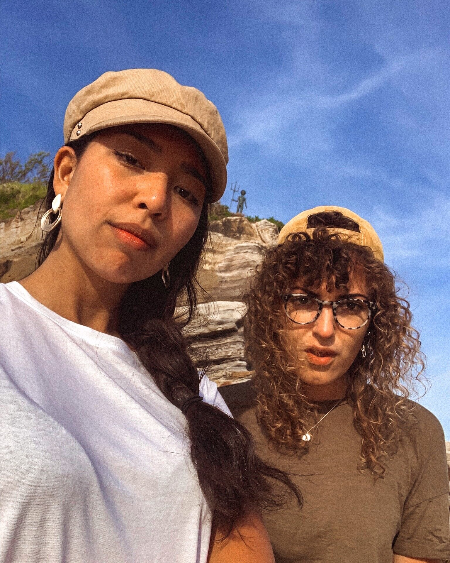 two-girl-friends-santander-merman-statue-spain.jpg
