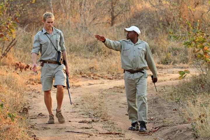 Hayman (left) with tracker and mentor Jack Sibuyi (right). Image by Josh Lustyan