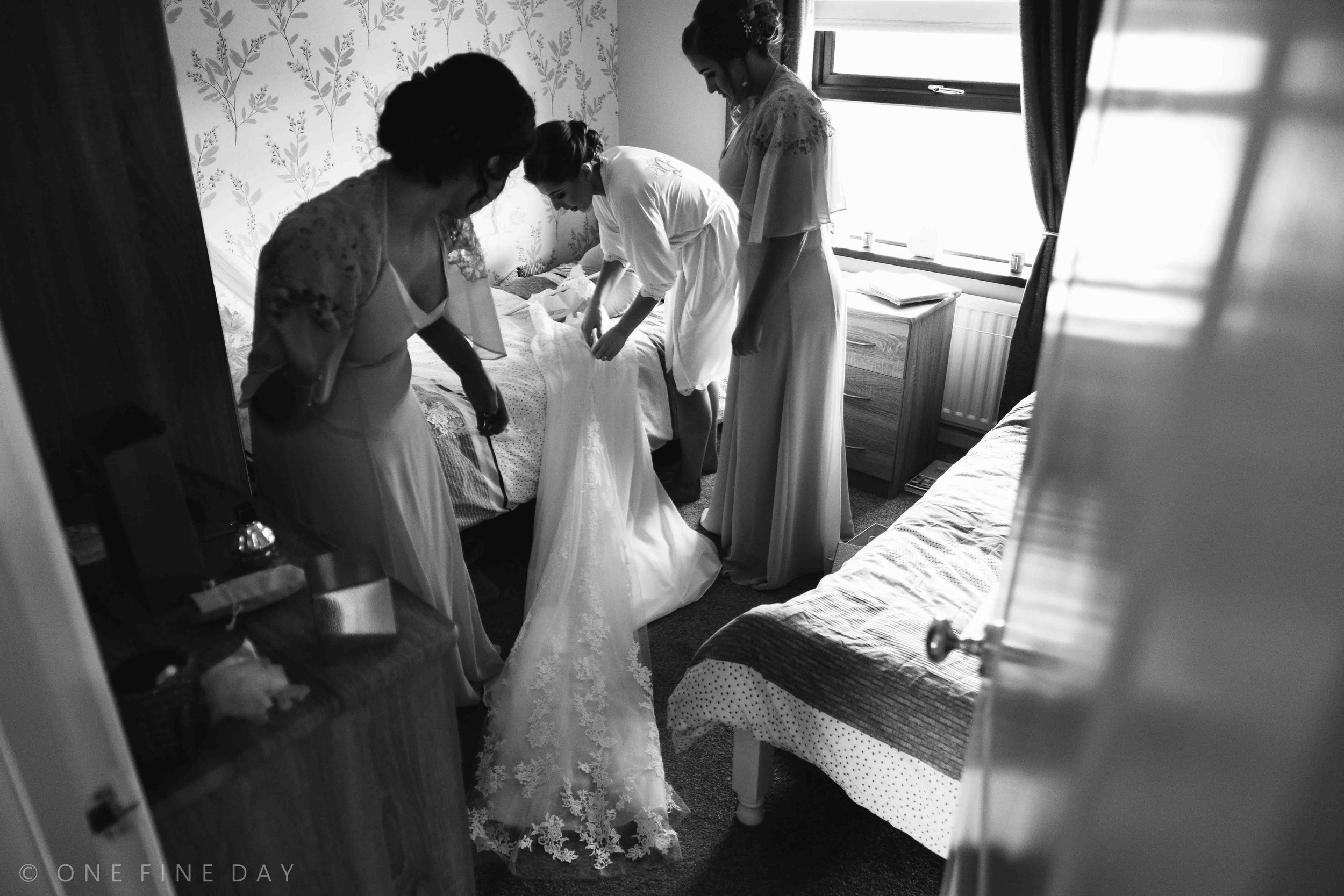 Bride getting ready in documentary style wedding image