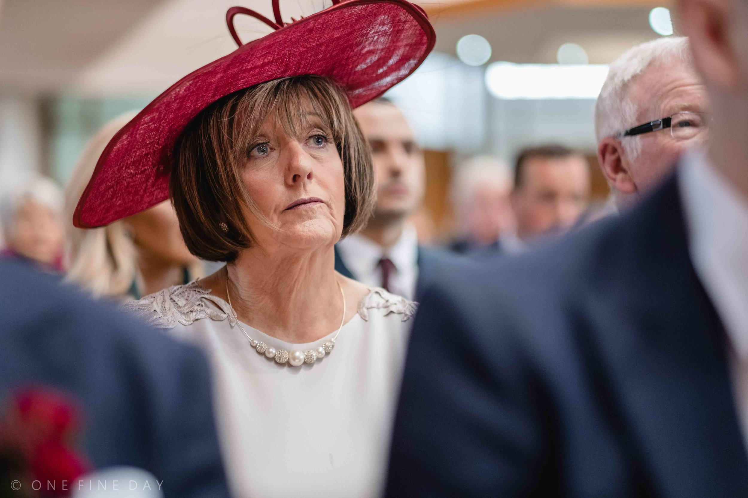 Mother of groom looking emotional in natural wedding photograph