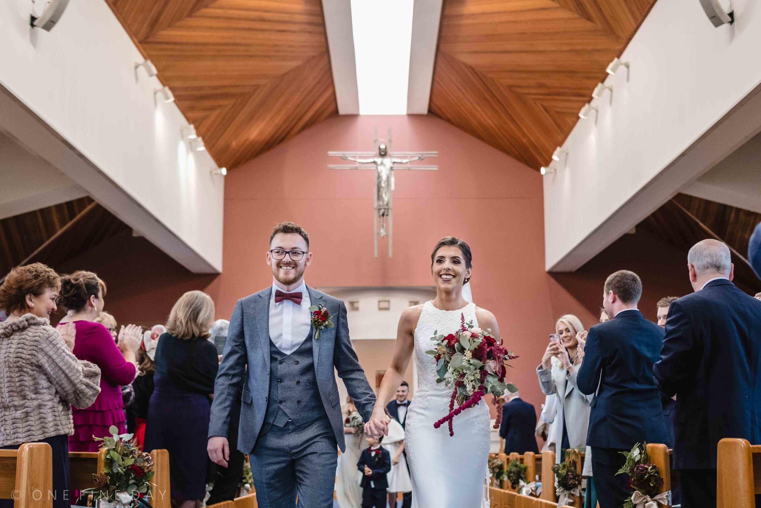 Bride and Groom walk out of church in northern Ireland
