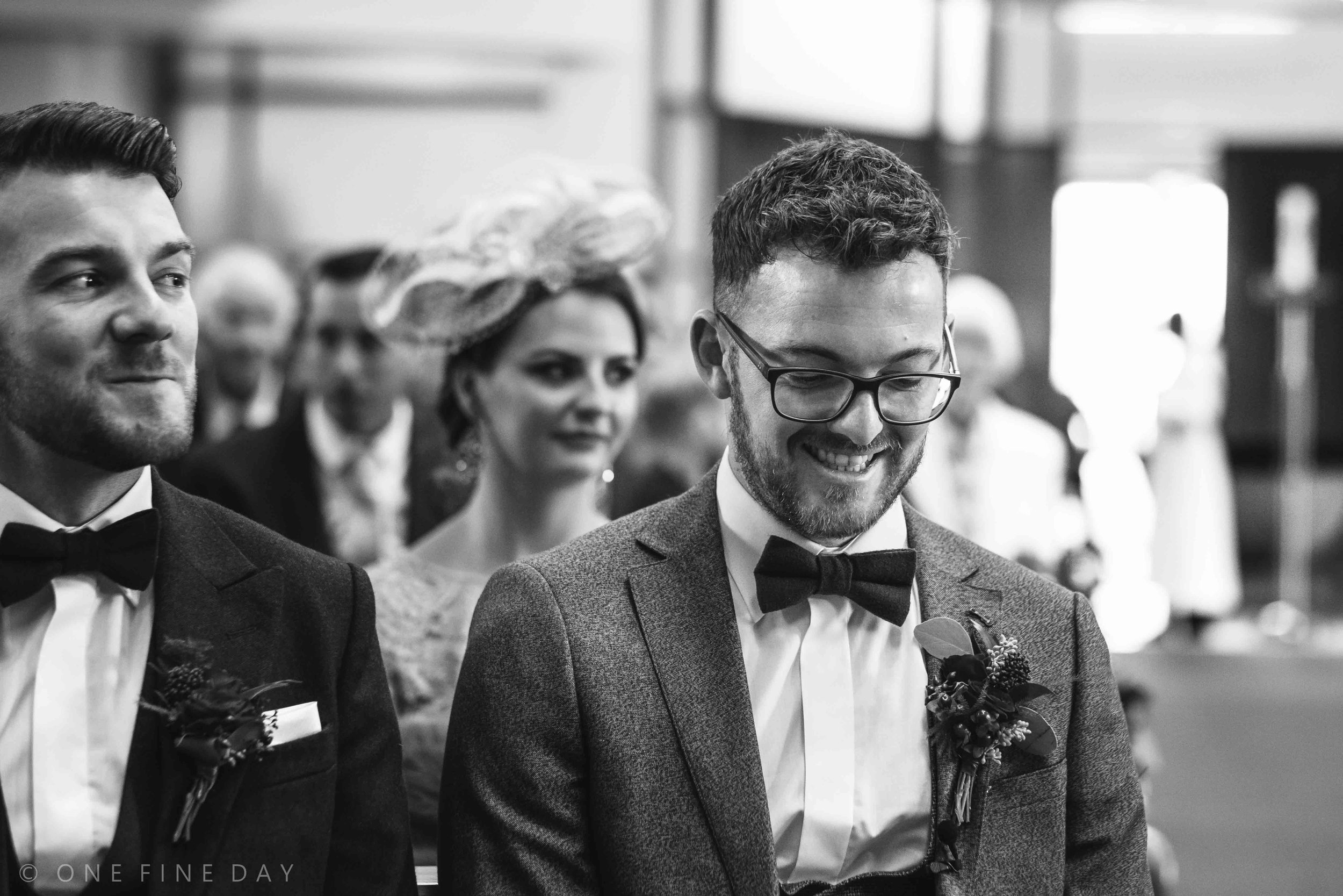 Nervous groom at wedding ceremony in black and white