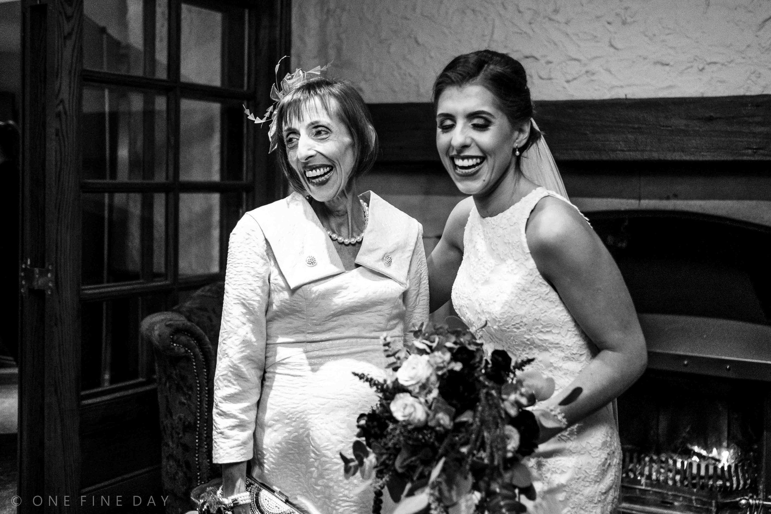 Bride and her Mum laughing at Ballygally castle