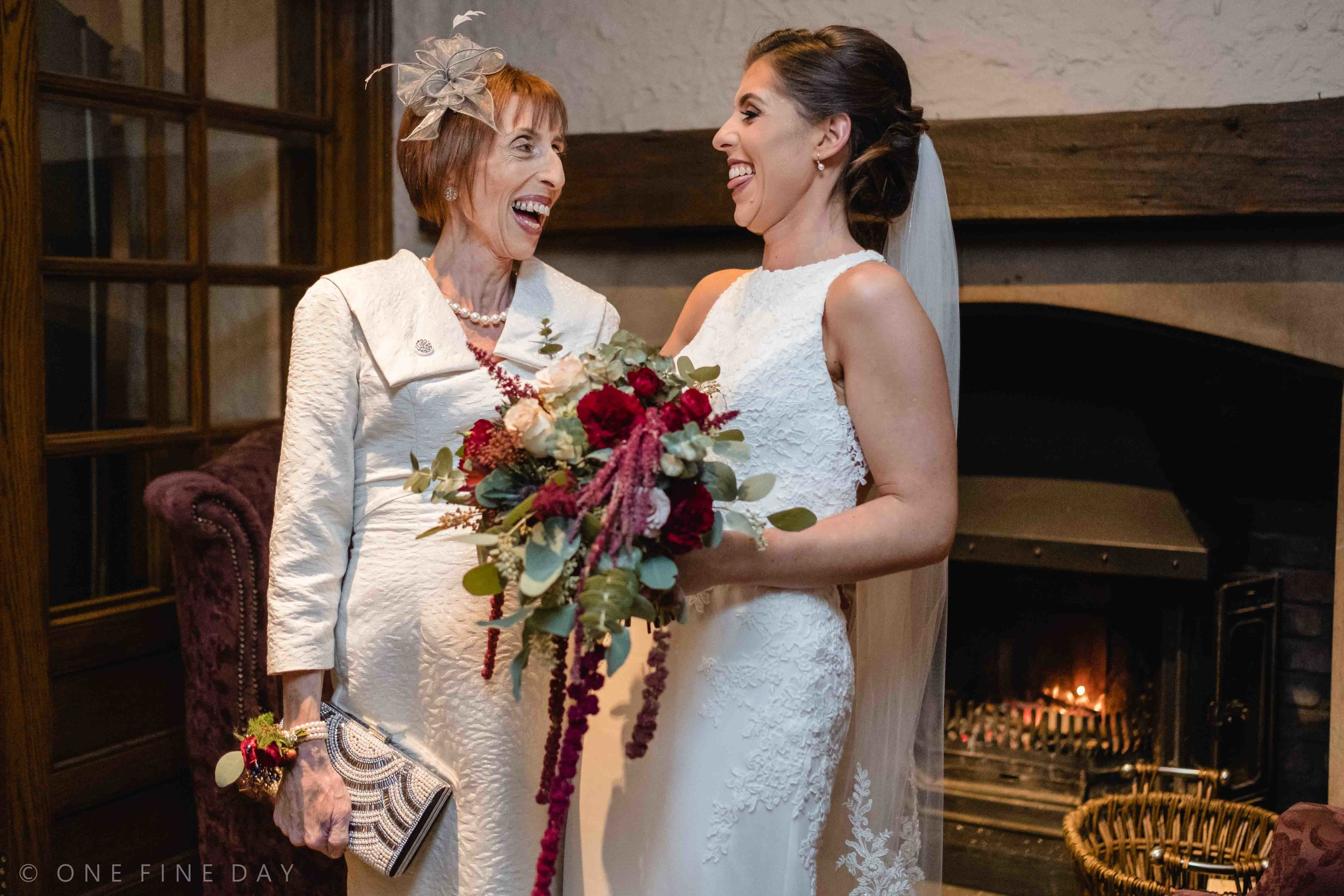 Mother of the bride and her daughter at wedding natural and relaxed