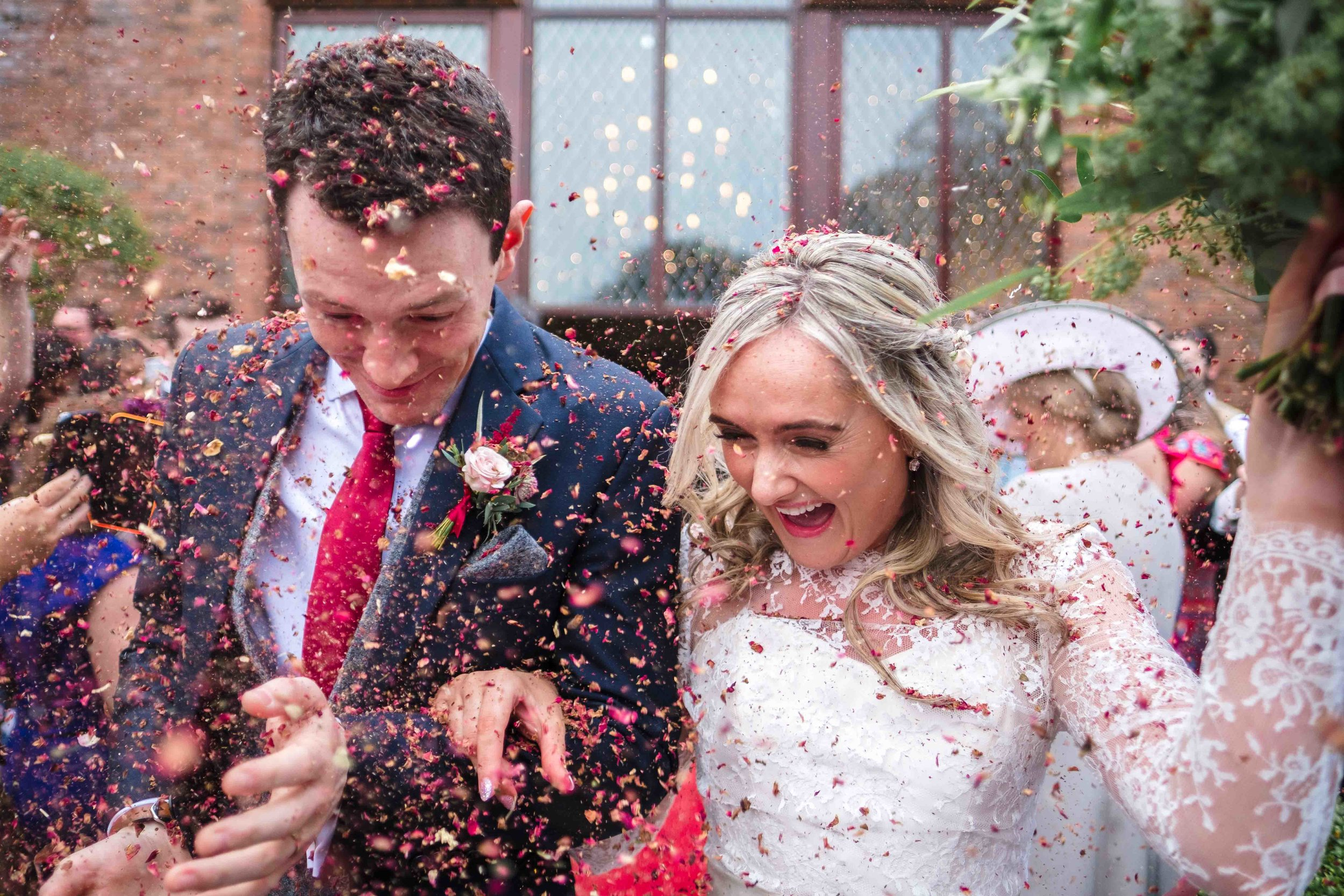 Bride and Groom in Confetti at their wedding in Northern Ireland