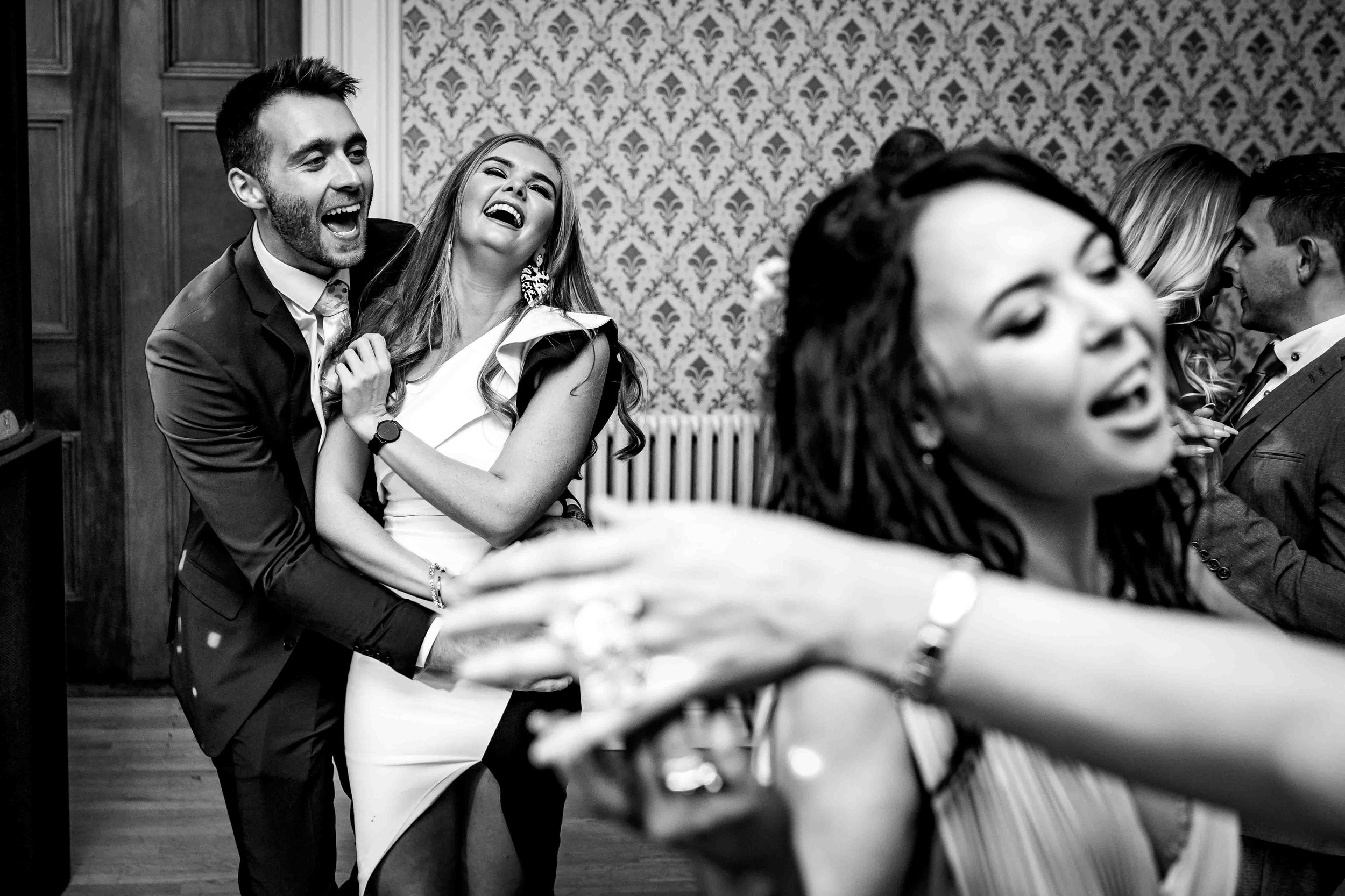 Relaxed and natural photograph of wedding Guests Dancing and laughing