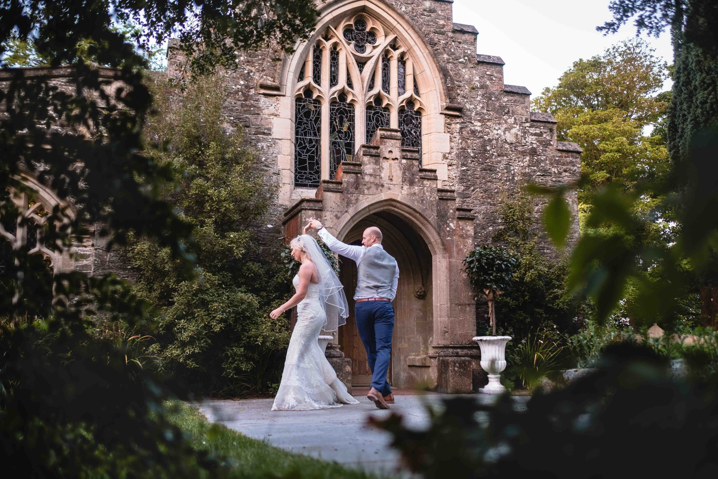 Candid photograph of the bride and Groom practising their first dance, Old Court Chapel Wedding Venue Northern Ireland