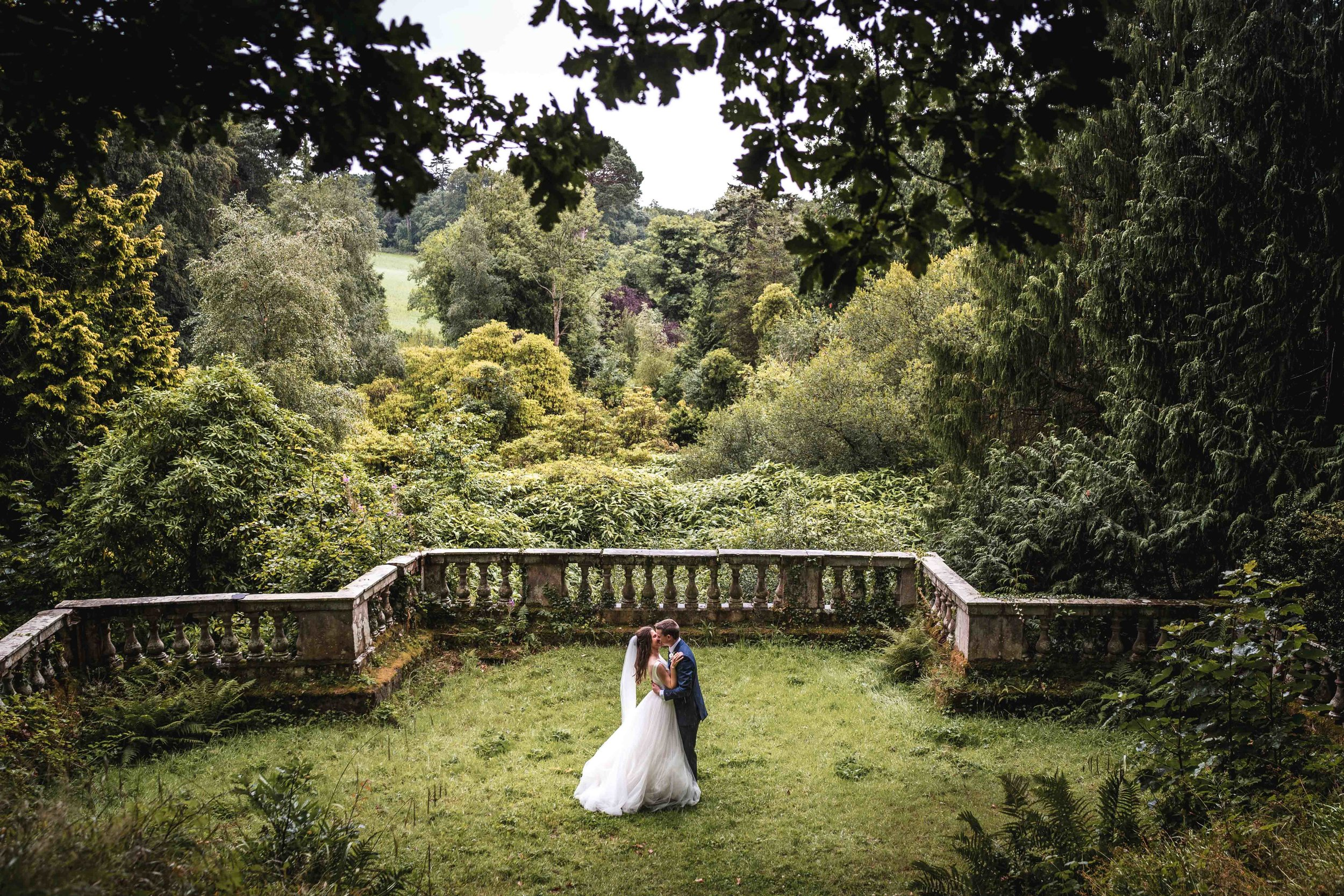 Bride and Groom Embrace in Woodland Surroundings of Drenagh House, Ireland