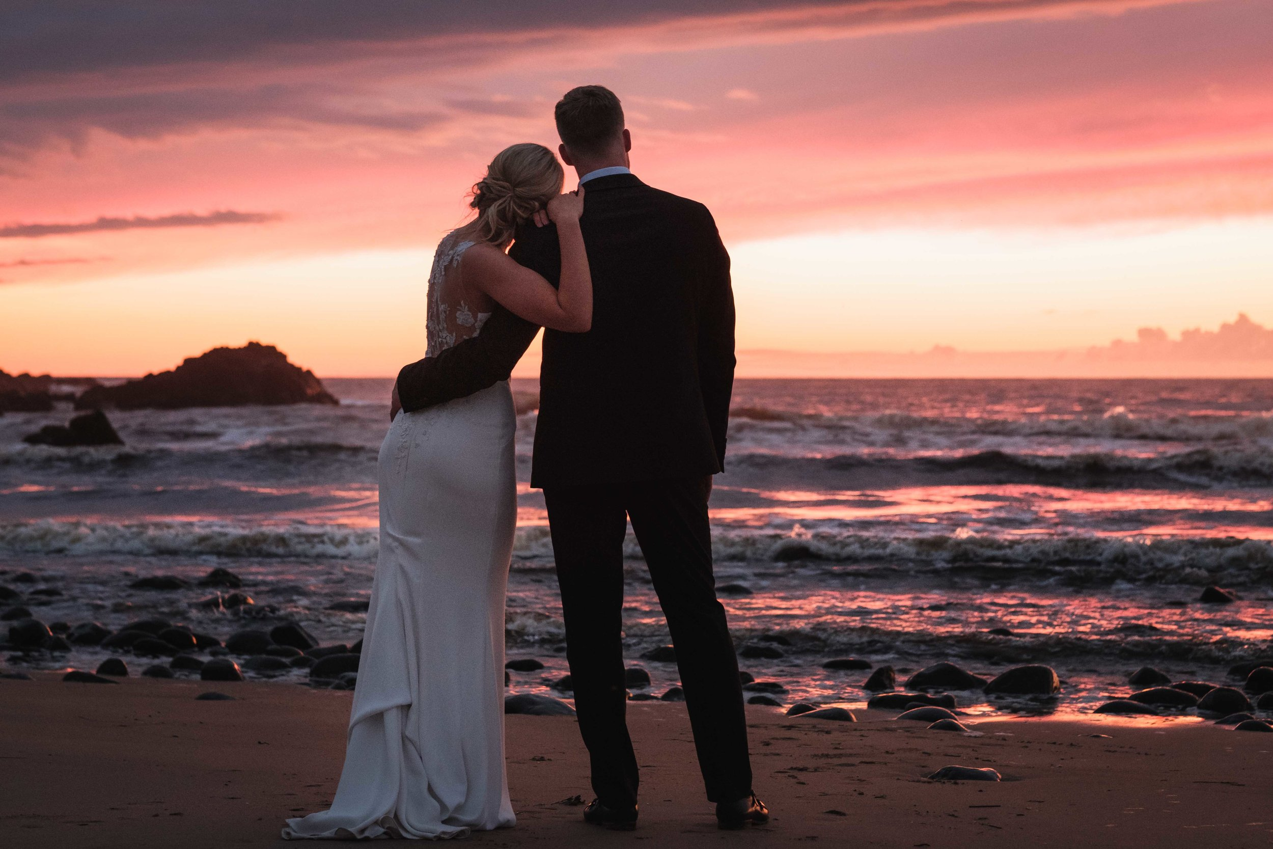 Natural and Relaxed Image of the Bride and Groom at Sunset at their wedding on The North Coast of Ireland
