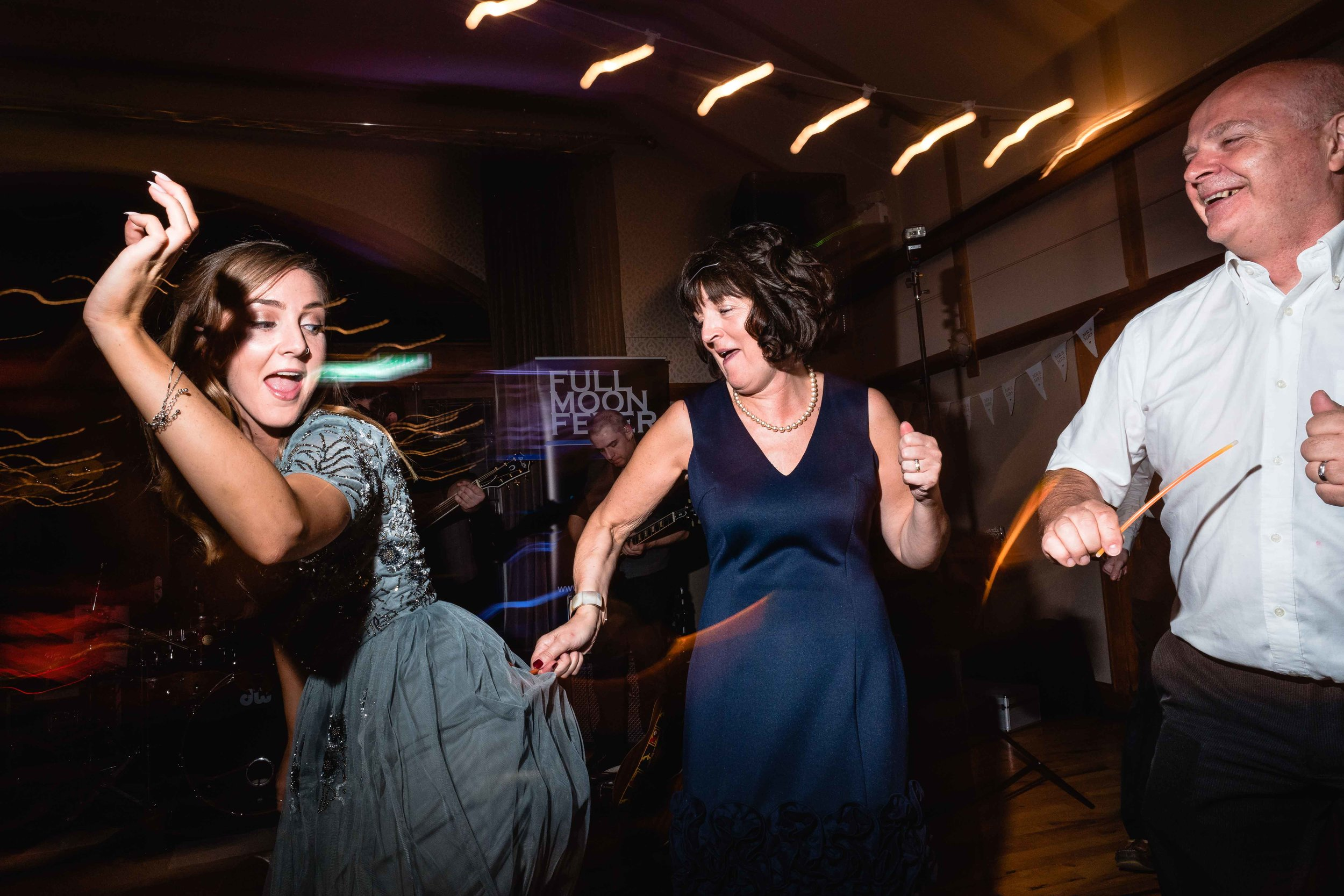 Natural candid photograph of guests dancing at a wedding in Ireland