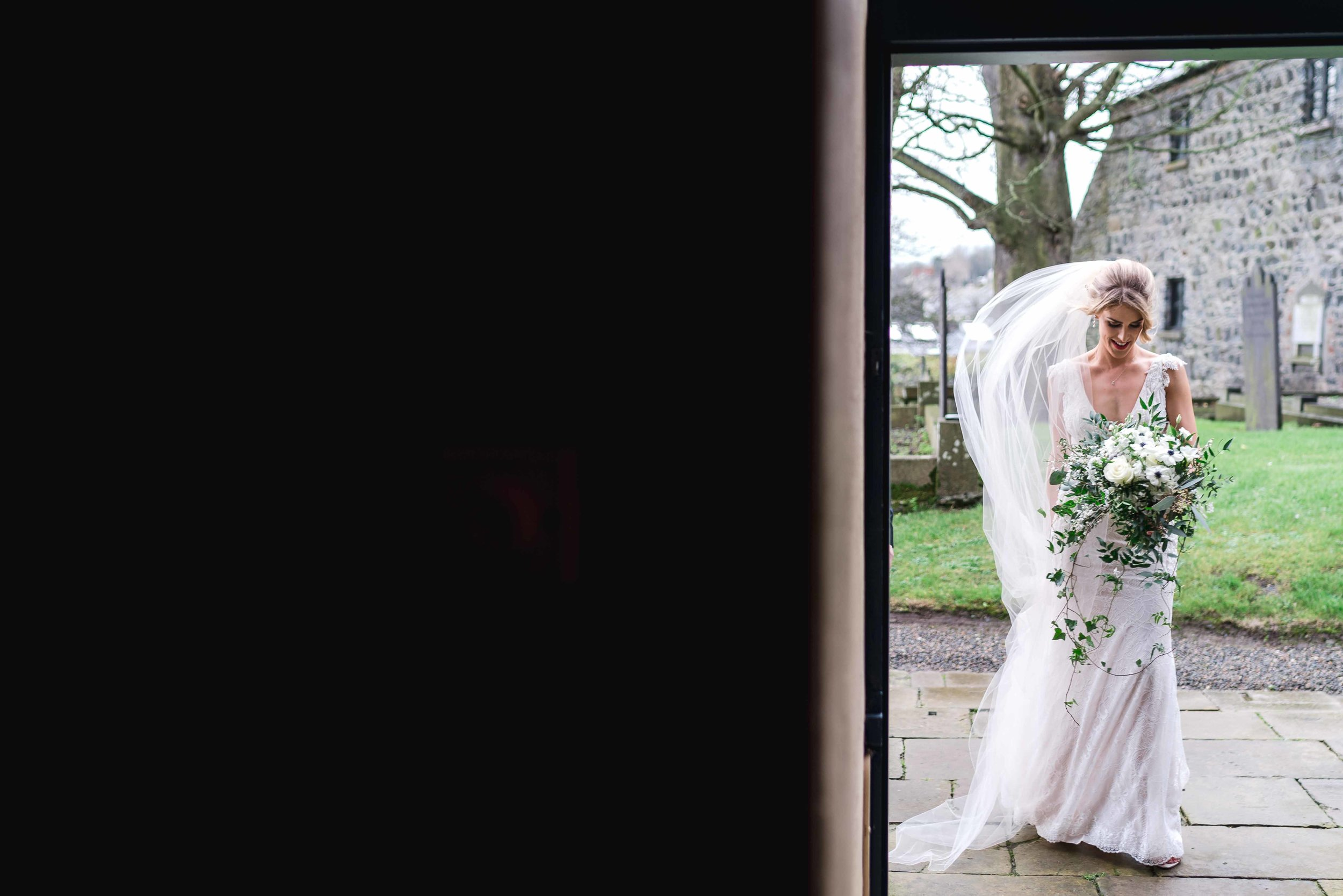 Natural Image of Bride as she enters church on her wedding day in Carlingford, Ireland