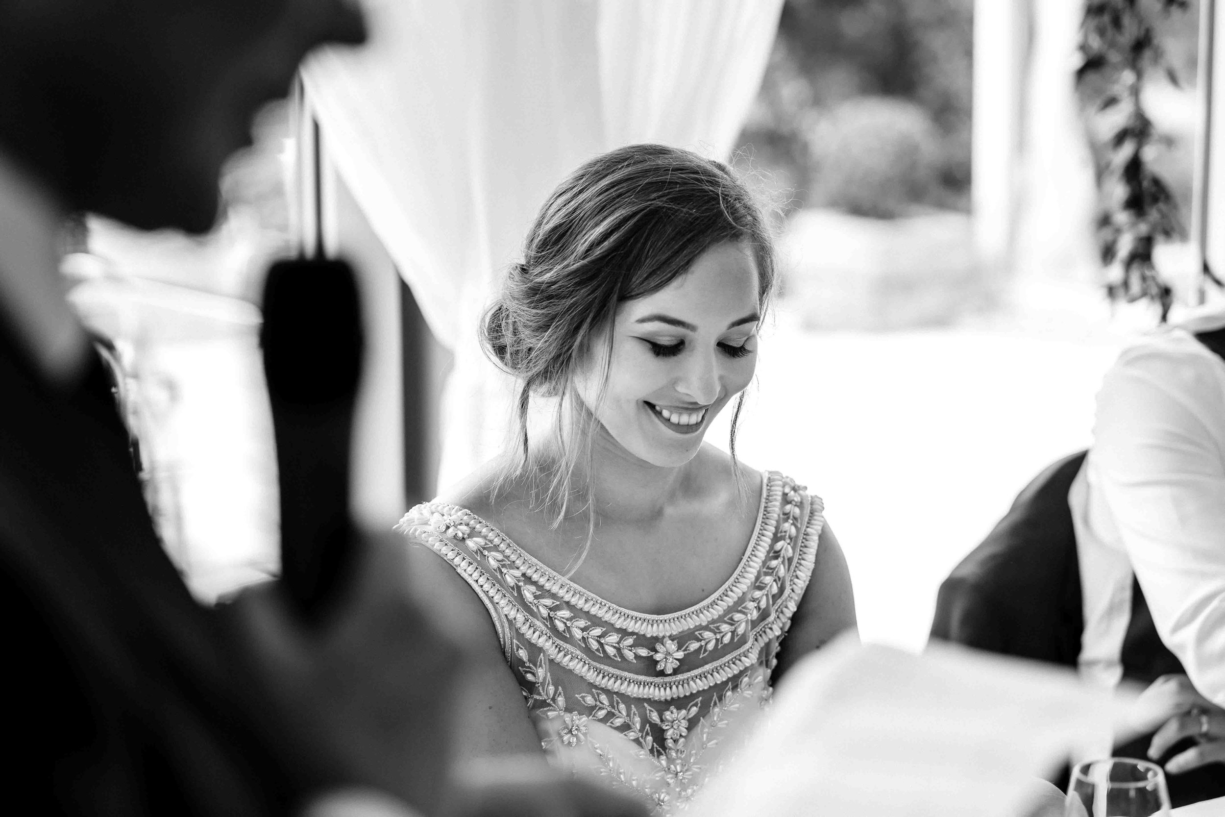 Intimate Photograph of bride during wedding speeches at Ballyscullion Park Northern Ireland