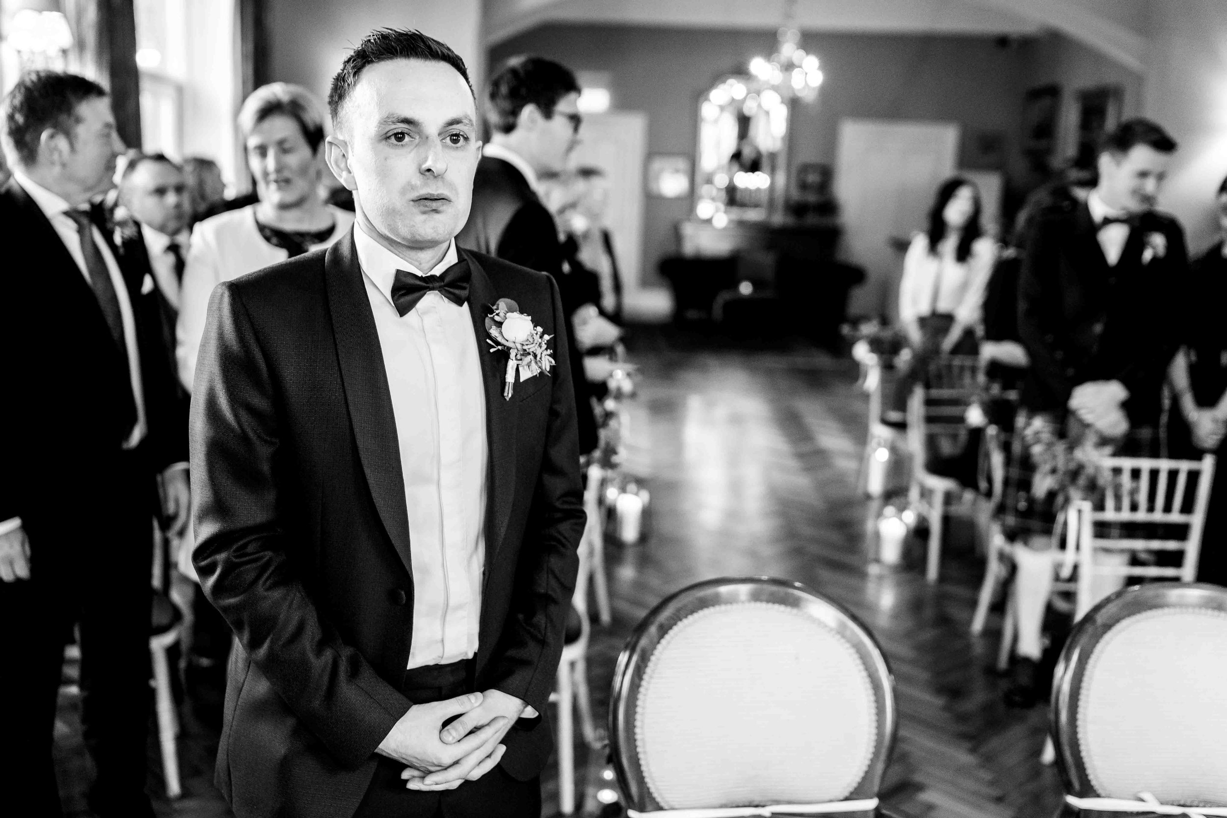 Natural photograph of nervous groom waiting for the bride at Tinakilly House, Wicklow