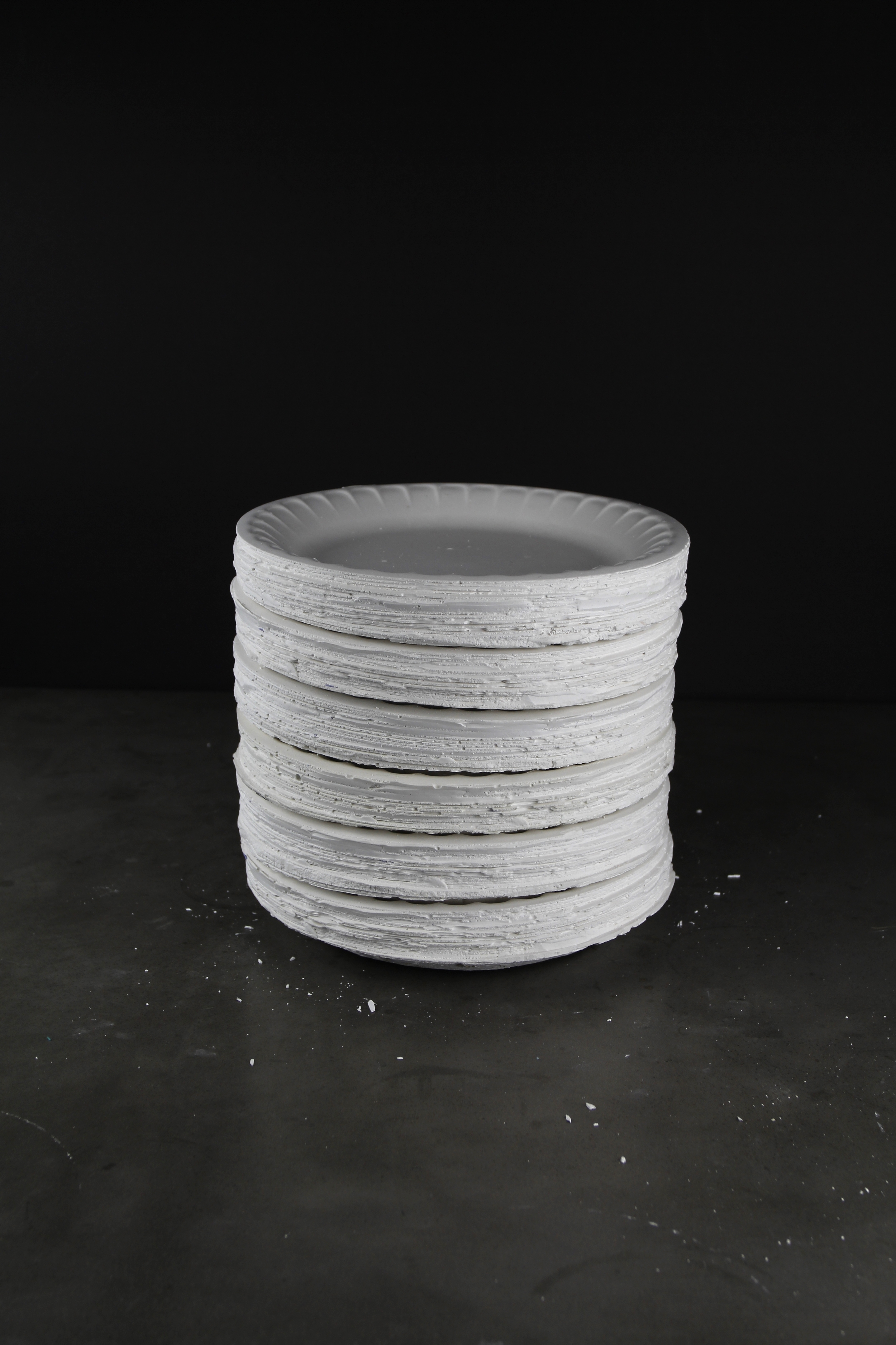 A stack of plates casted in plaster.