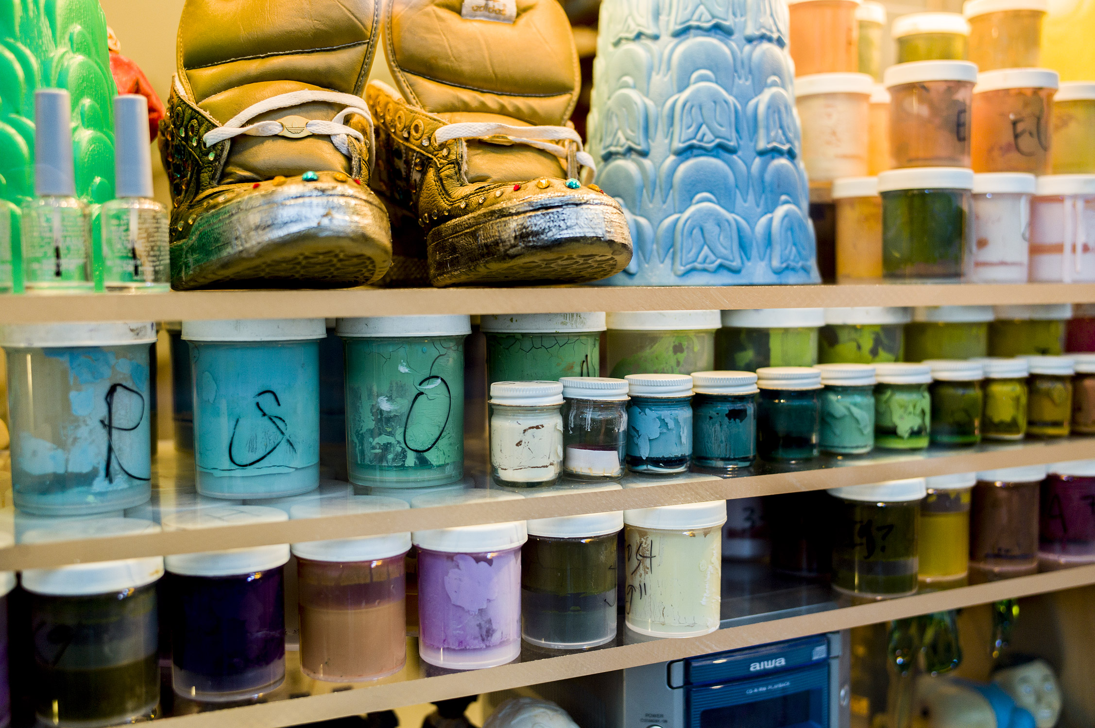 Detail of Ricci Albenda's paint-mixing containers, Adidas sneakers by Rosalie Knox