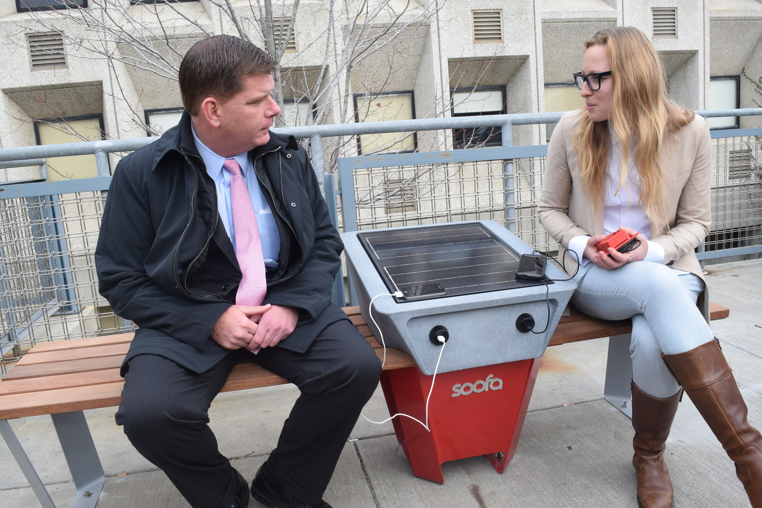 December 11: Mayor Marty Walsh and Soofa founder Sandra, chatting on the donated Soofa Bench. Sandra showed Mayor Walsh the new sensors Soofa has developed, housed in the nifty red box she is holding.