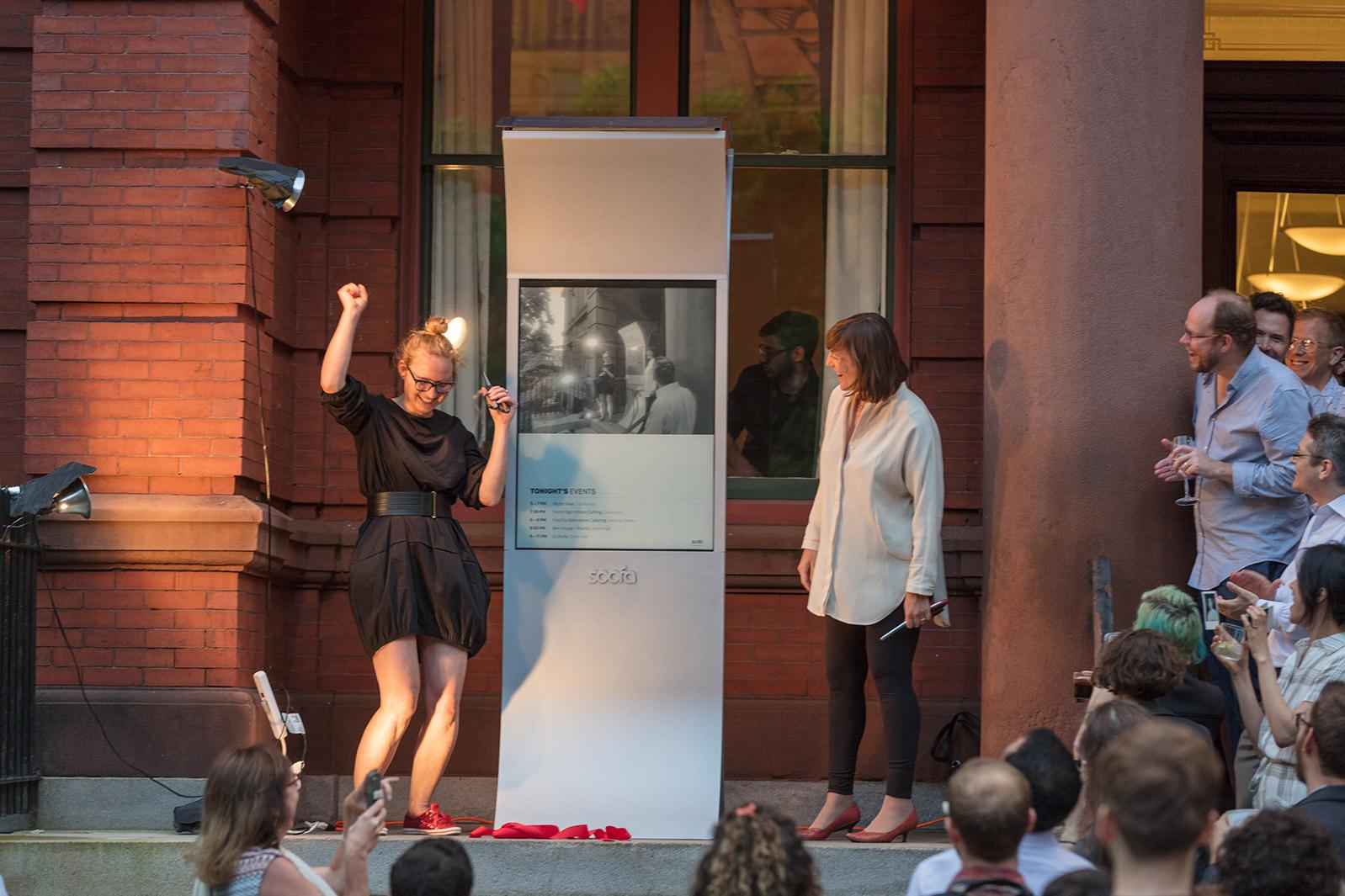 "Sandra and Jutta unveil the 42"" Soofa Sign."