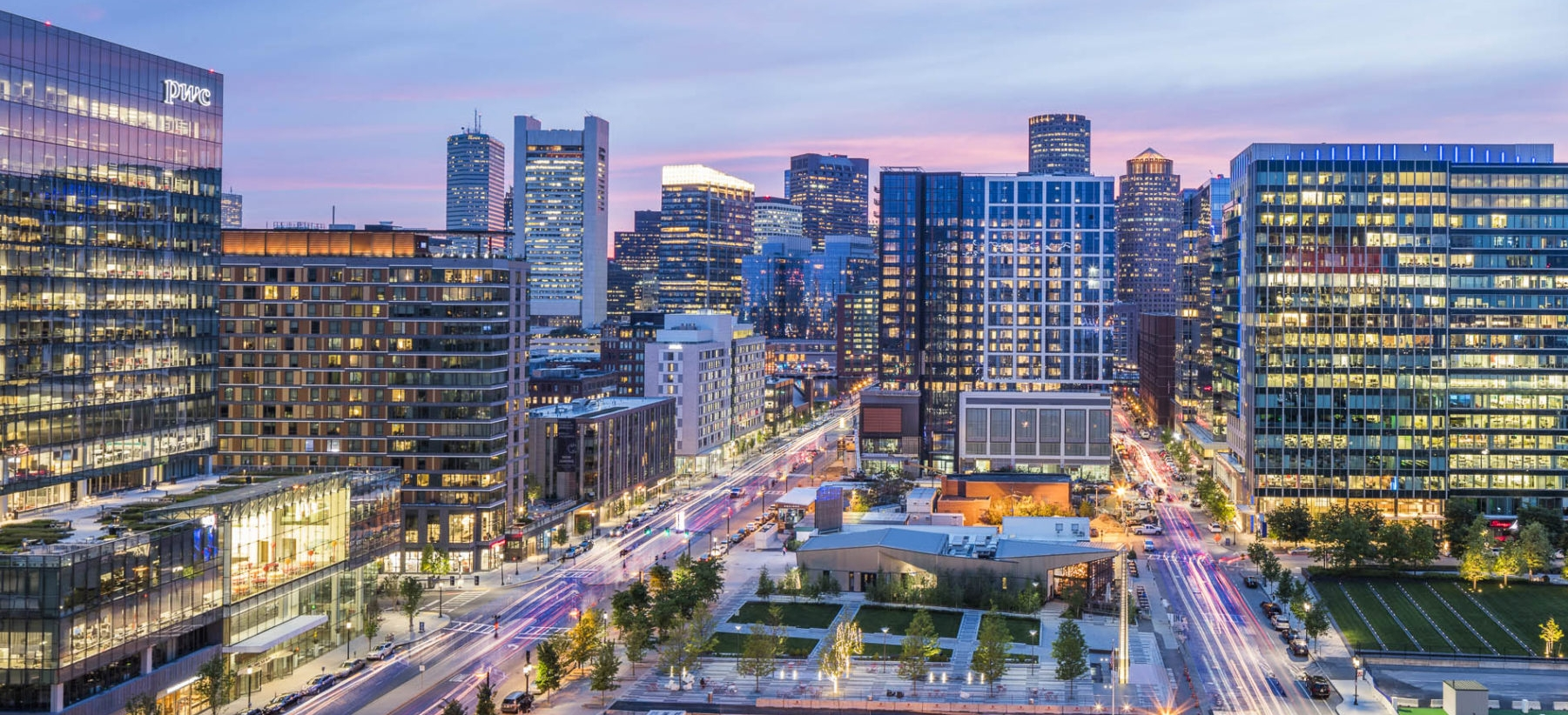 An aerial view of the Seaport District at night shows the newly-redeveloped neighborhood as bustling.