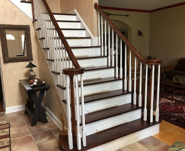 Re-stained staircase to match the new floors.