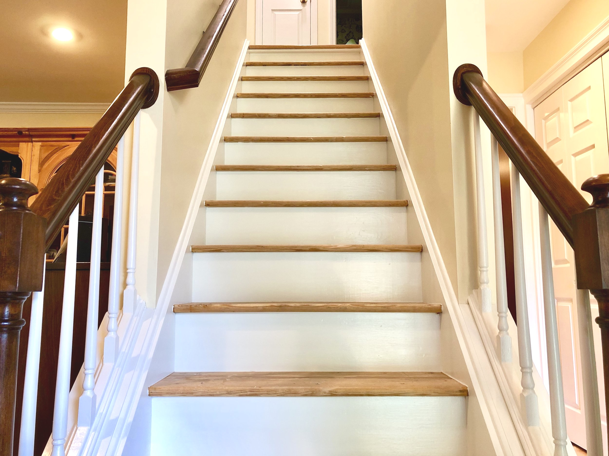 With painting the risers, side molding and spindles white it gave this staircase a new updated look. New treads and carpet runner to be added to complete the makeover.