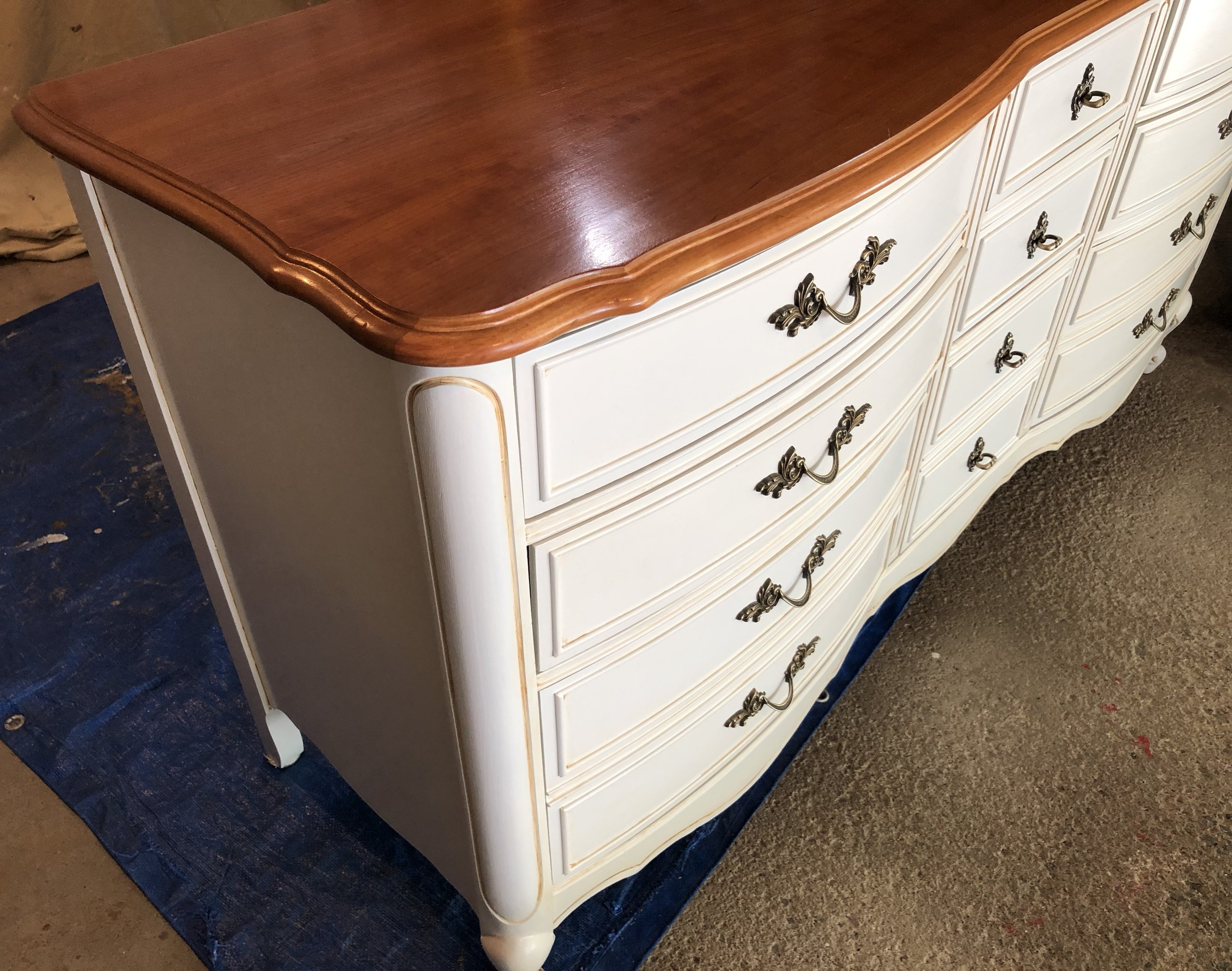 Top refinished and  base painted with custom glazing technique that shows off the beautiful detailing on this vintage bedroom furniture.